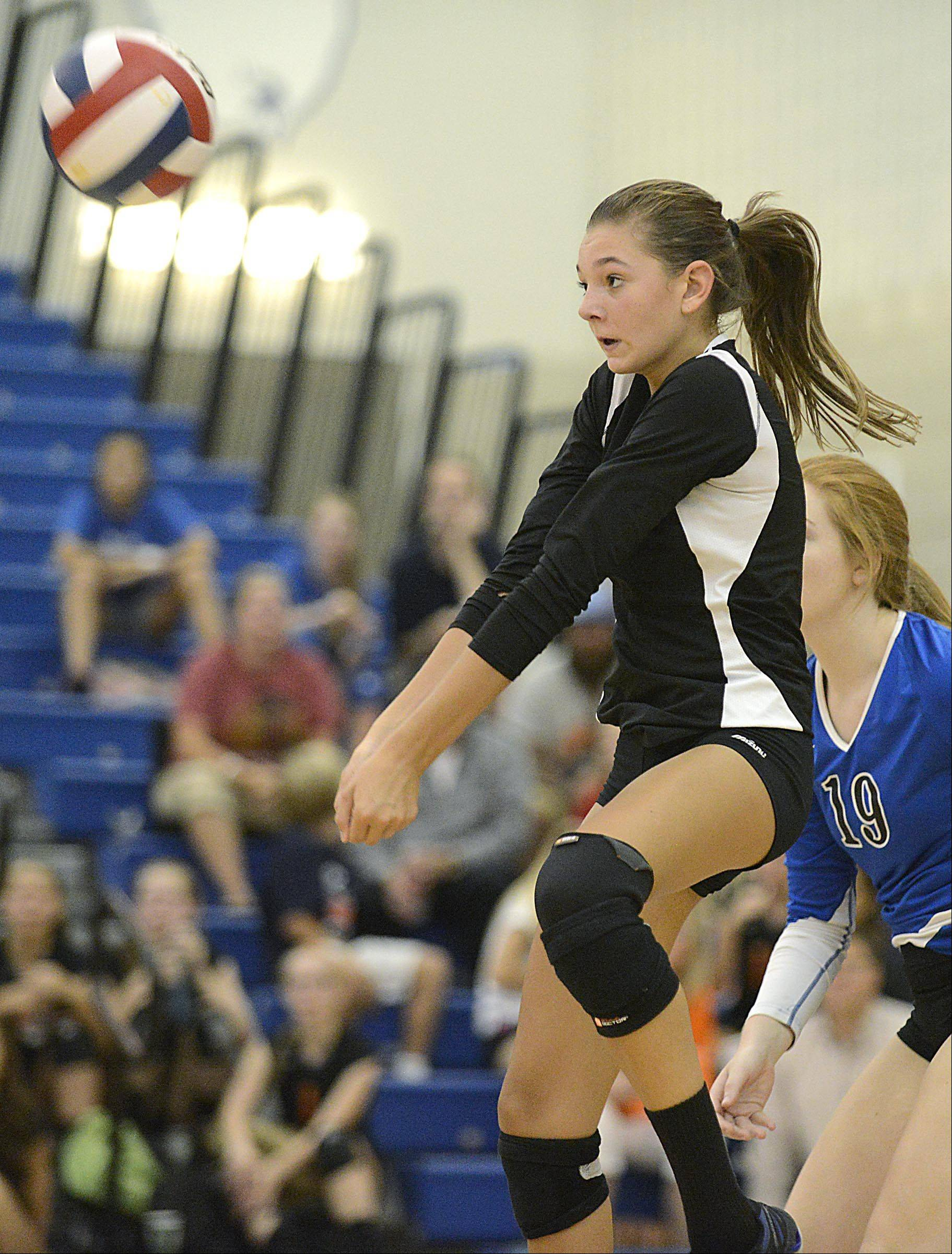 Geneva's Kelsey Wicinski returns a back row shot against Dekalb Thursday in Geneva.