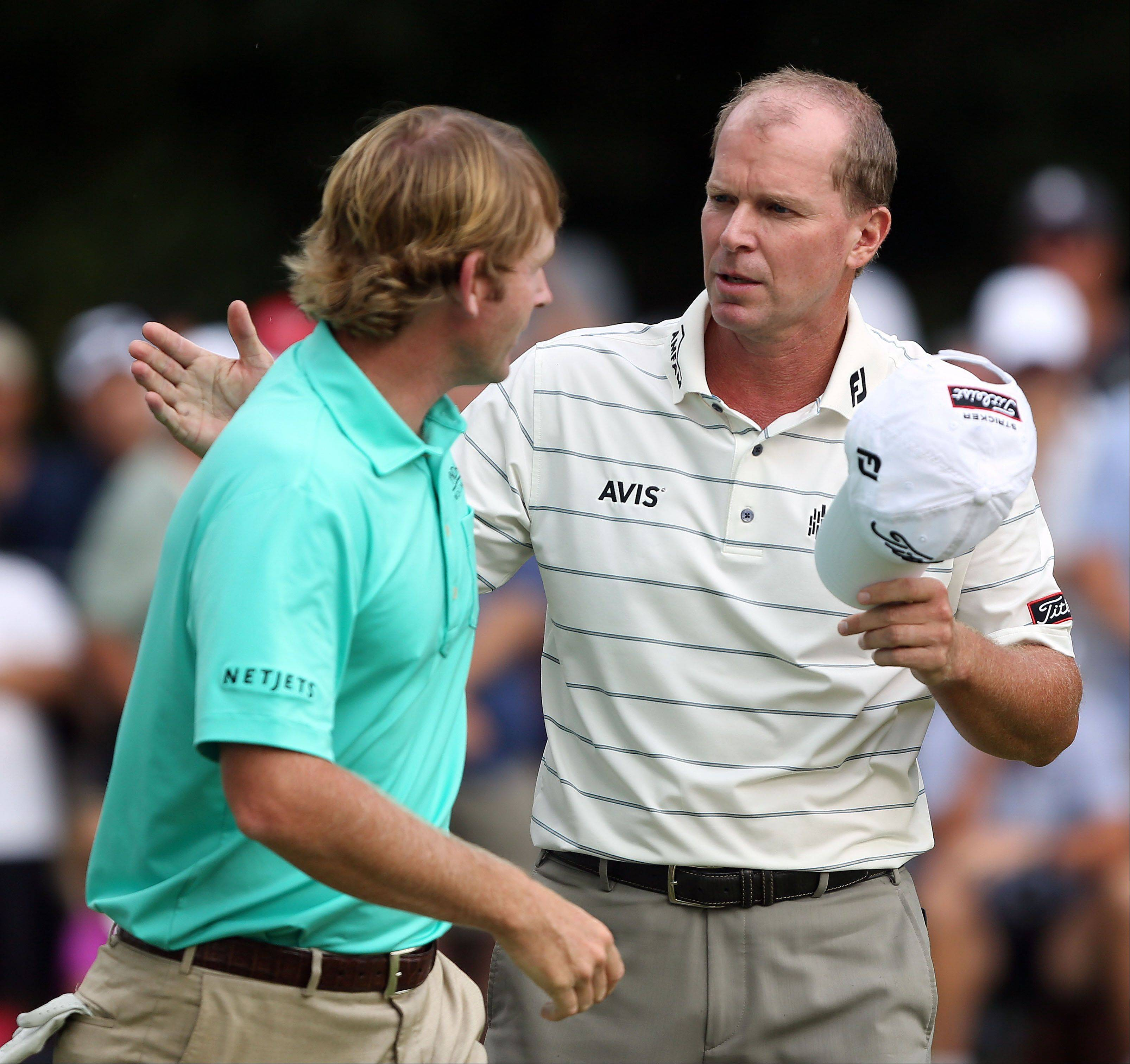 Brandt Snedeker and Steve Stricker shake hands after their round.