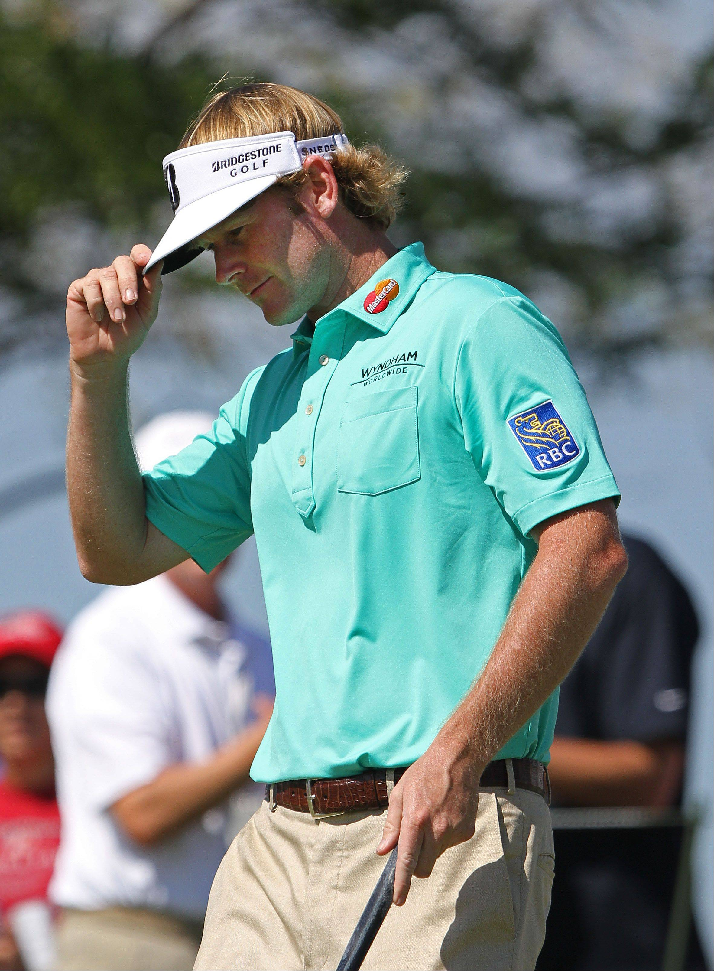 Brandt Snedeker tips his hat after making birdie on the 13th hole.