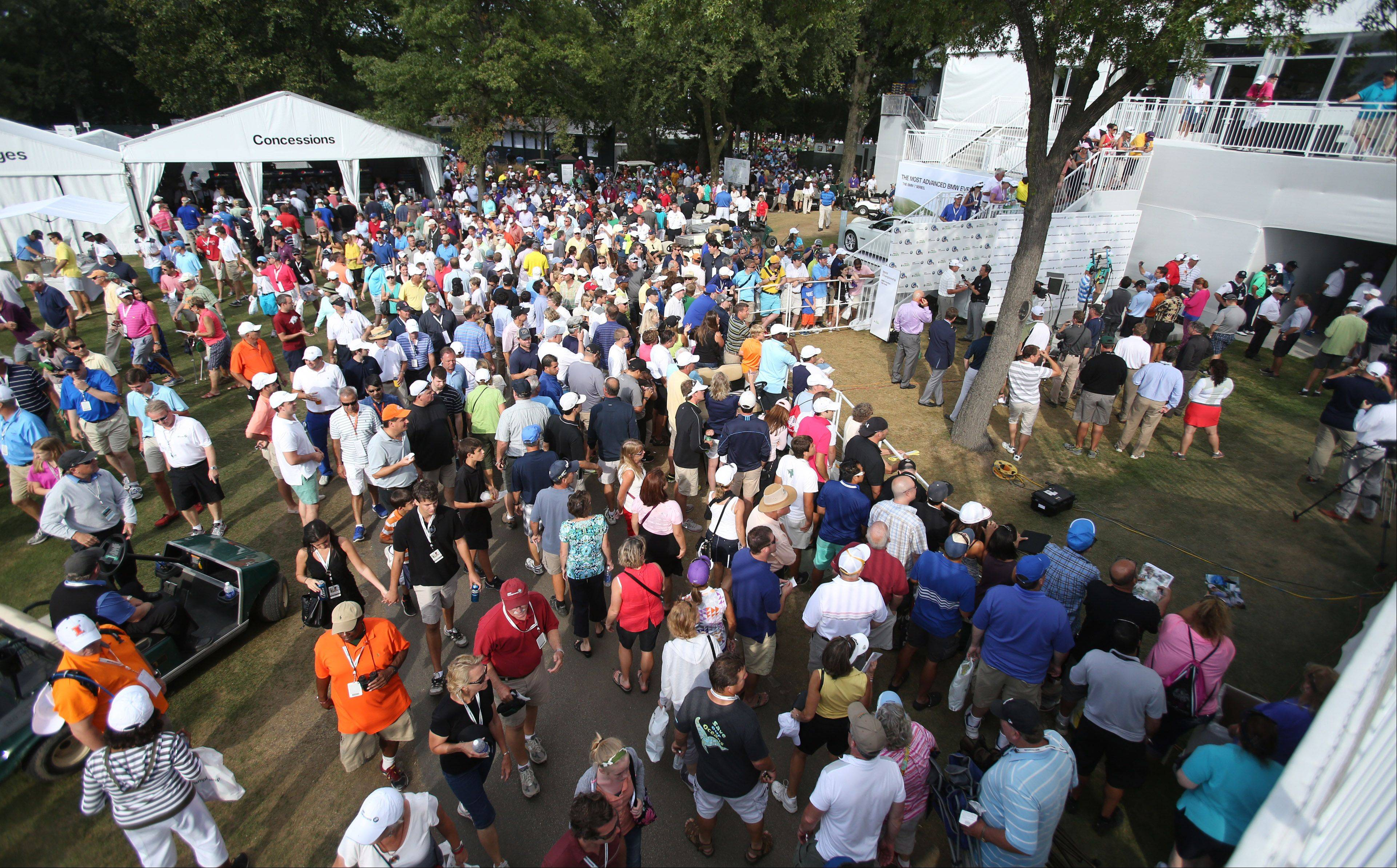 Fans wait to get Tiger Woods' autograph.