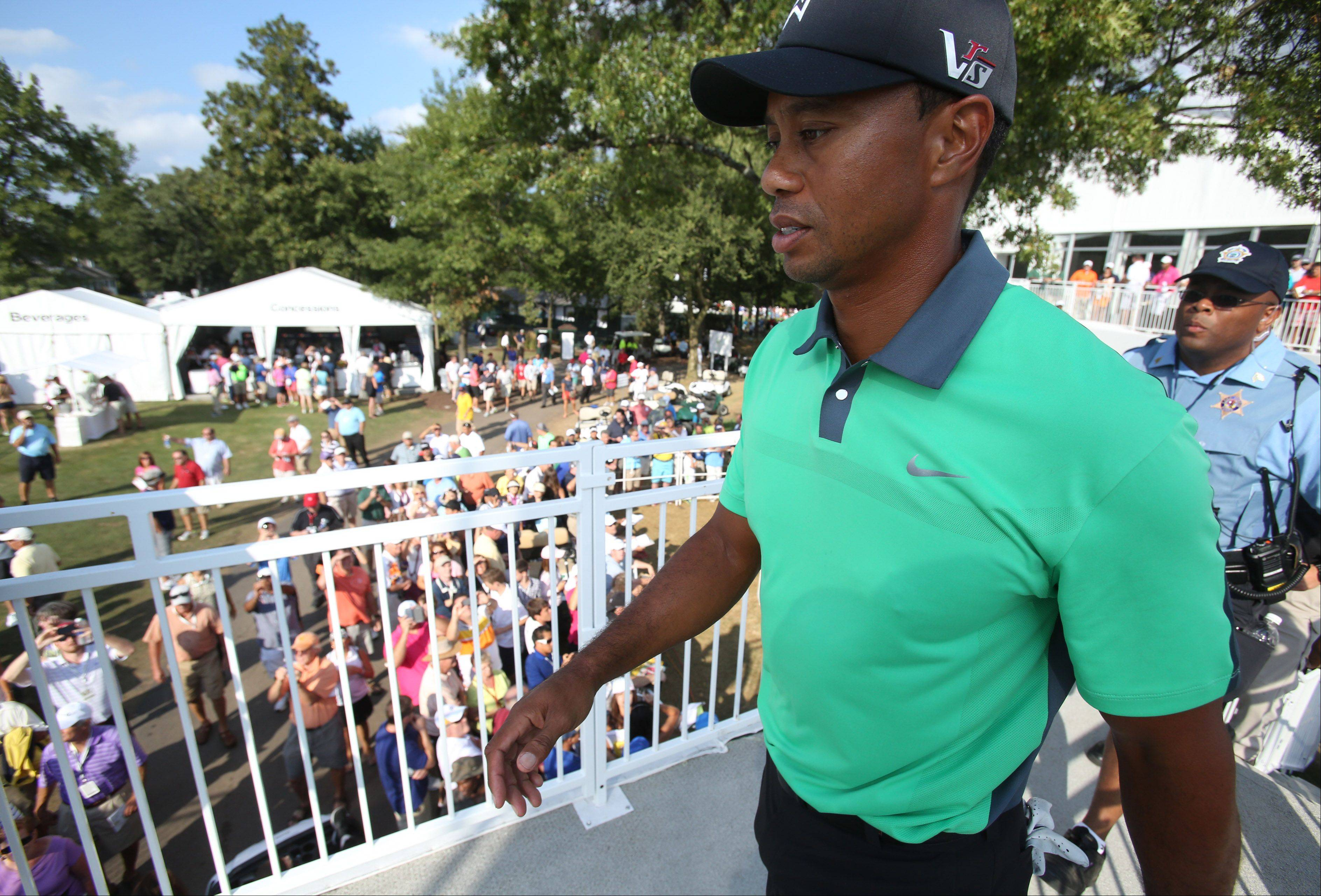 Tiger Woods' heads to the clubhouse after his round.