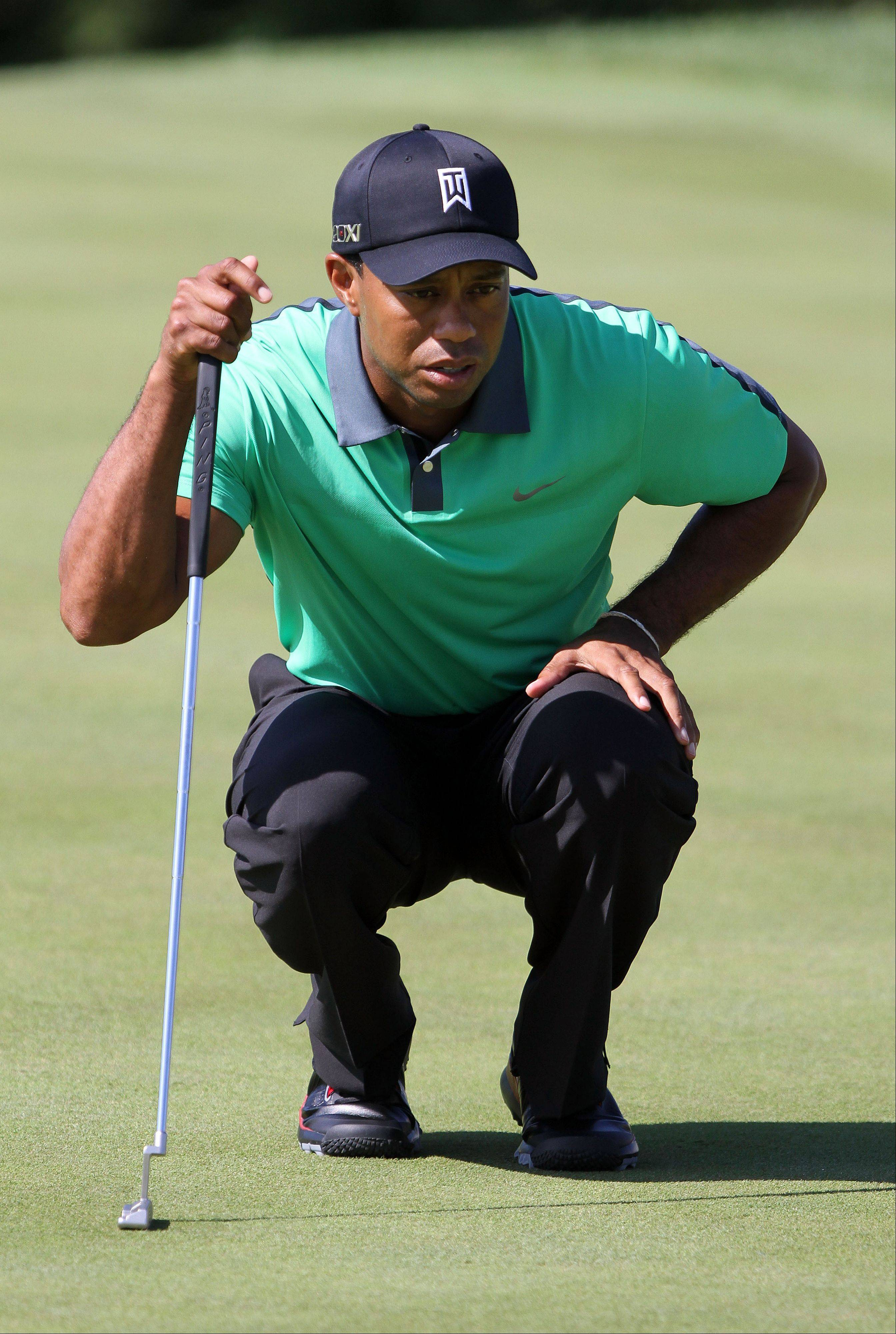 Tiger Woods lines up a putt on the 10th hole.