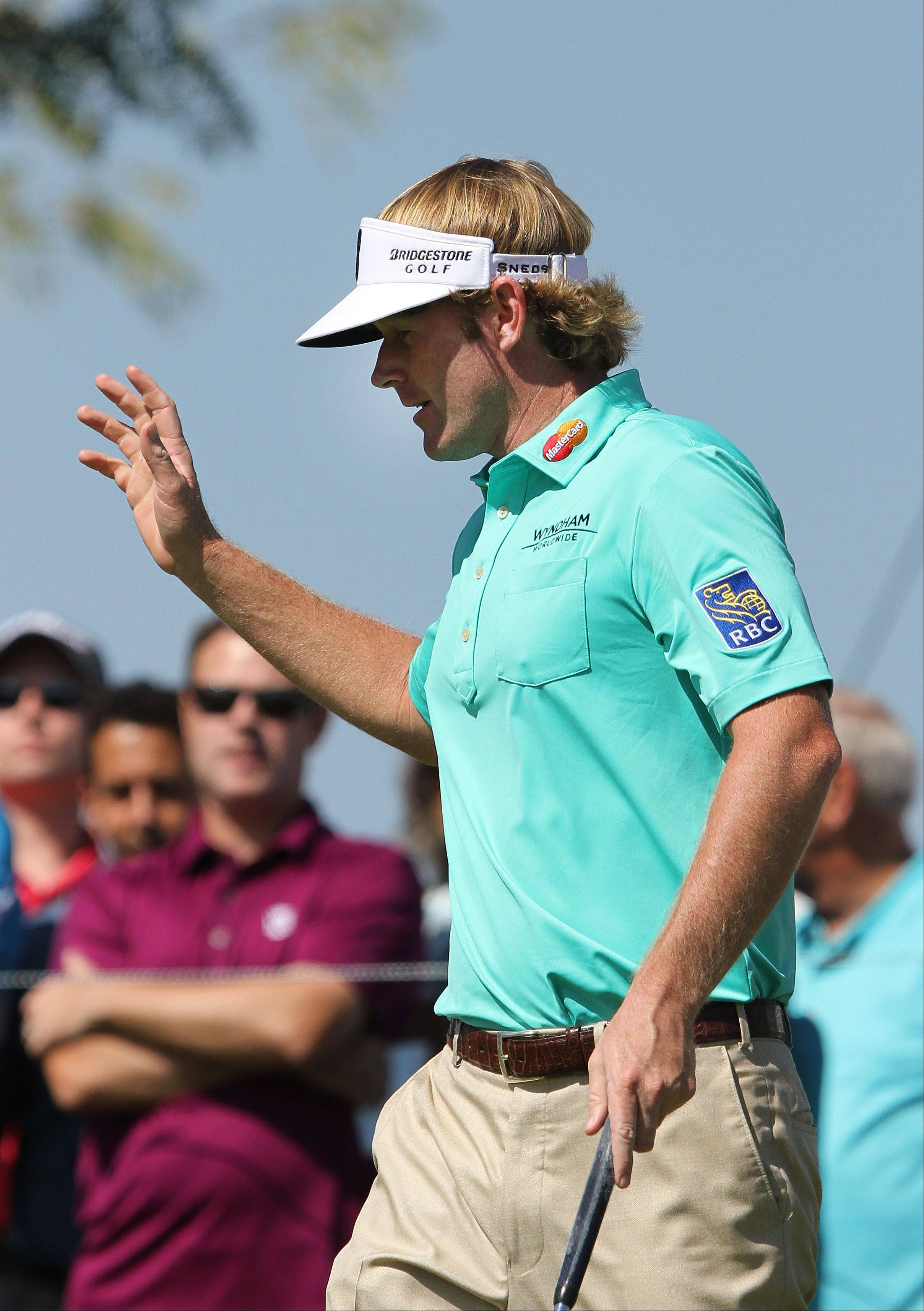 Brandt Snedeker waves to the crowd after making birdie on the 13th hole.