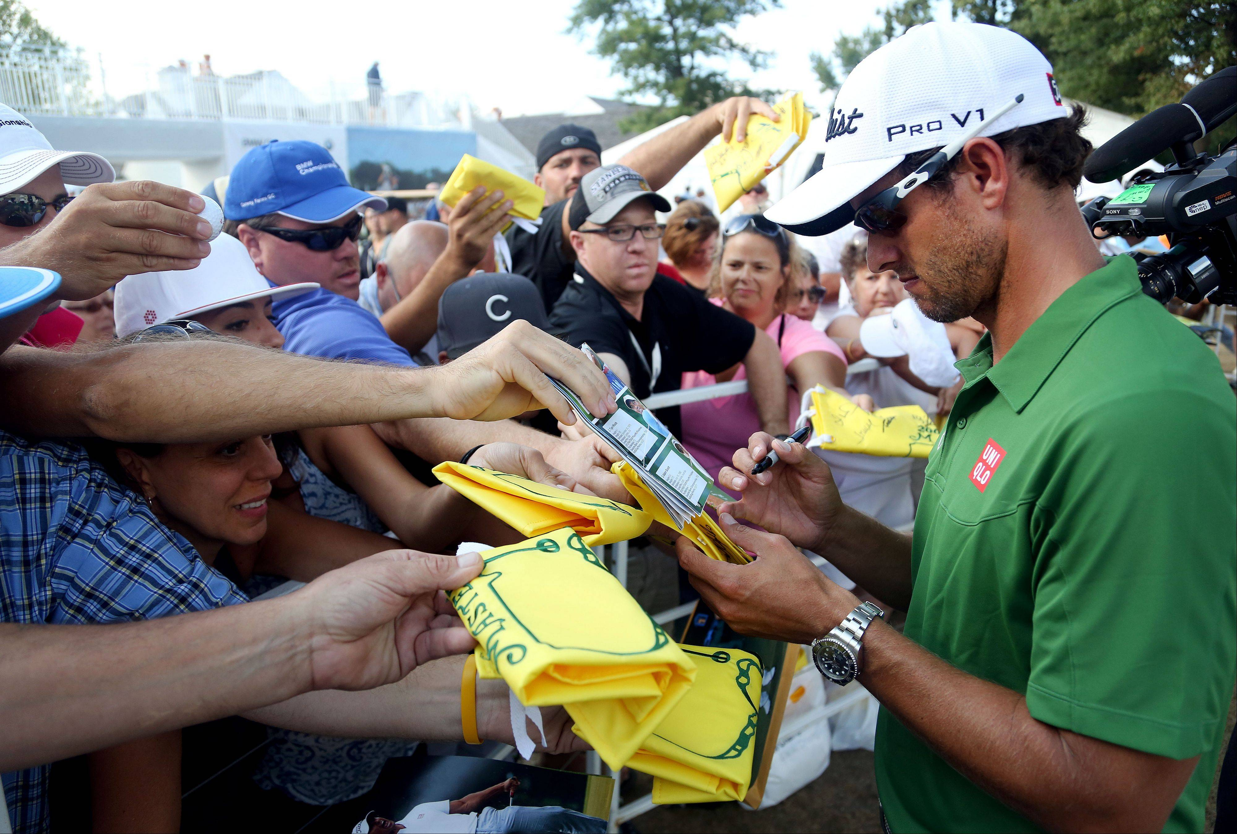 Adam Scott signs autographs.