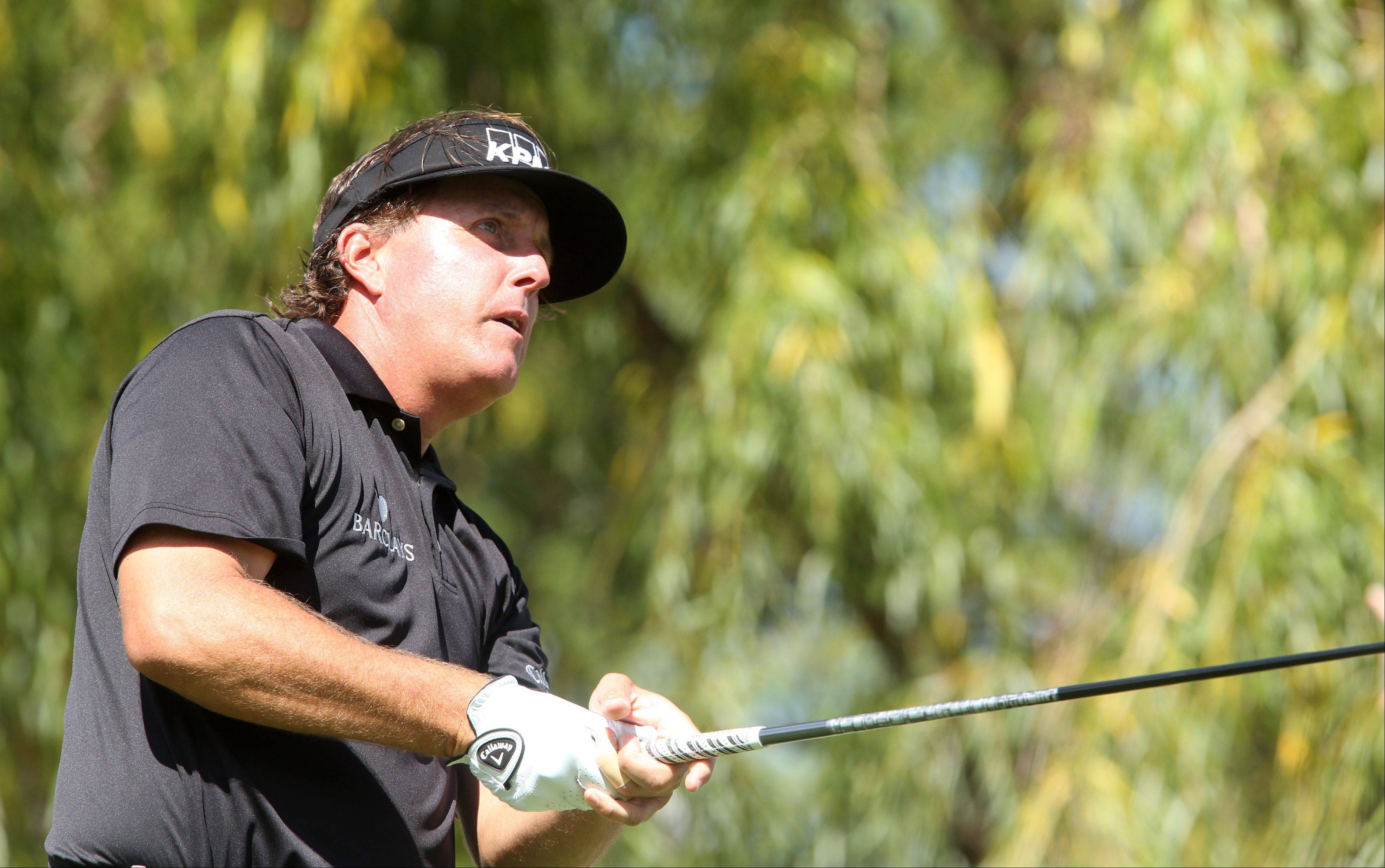Phil Mickelson tees off on the 4th hole.