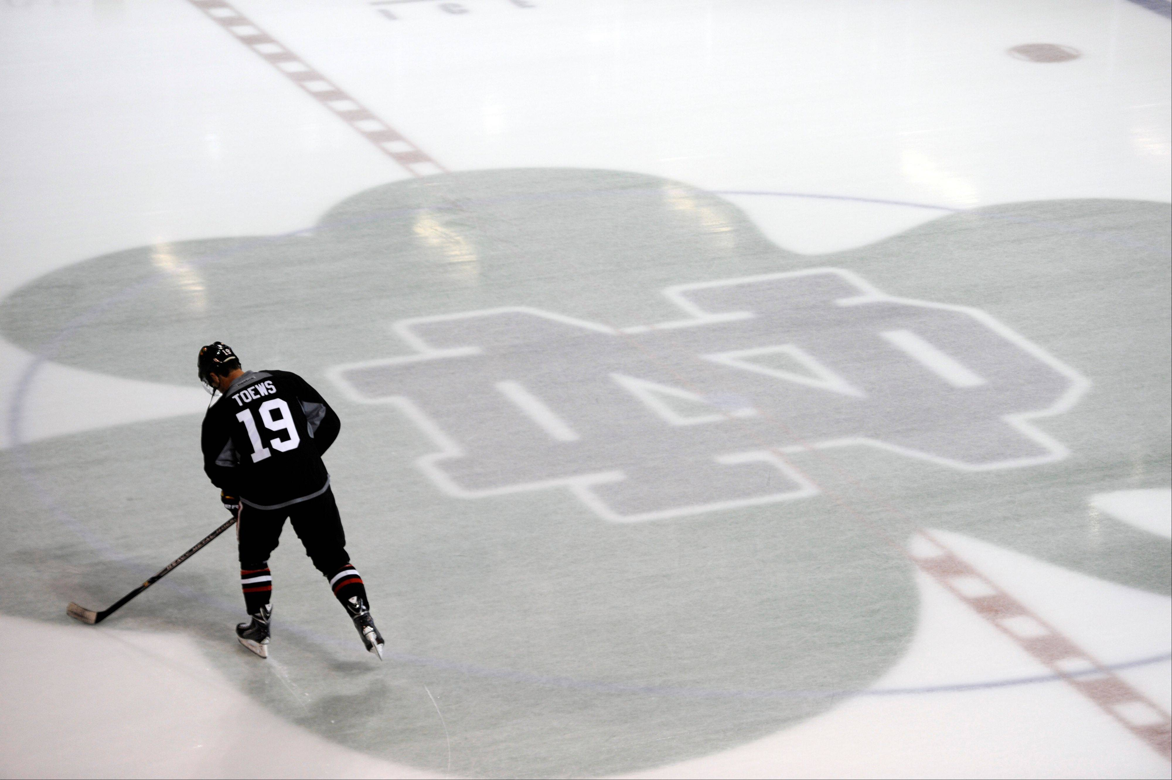Blackhawks captain Jonathan Toews glides across the Notre Dame logo during training camp Thursday at the Compton Family Ice Arena in South Bend. The $50 million area opened in 2011, and the Hawks will spend five days on campus.