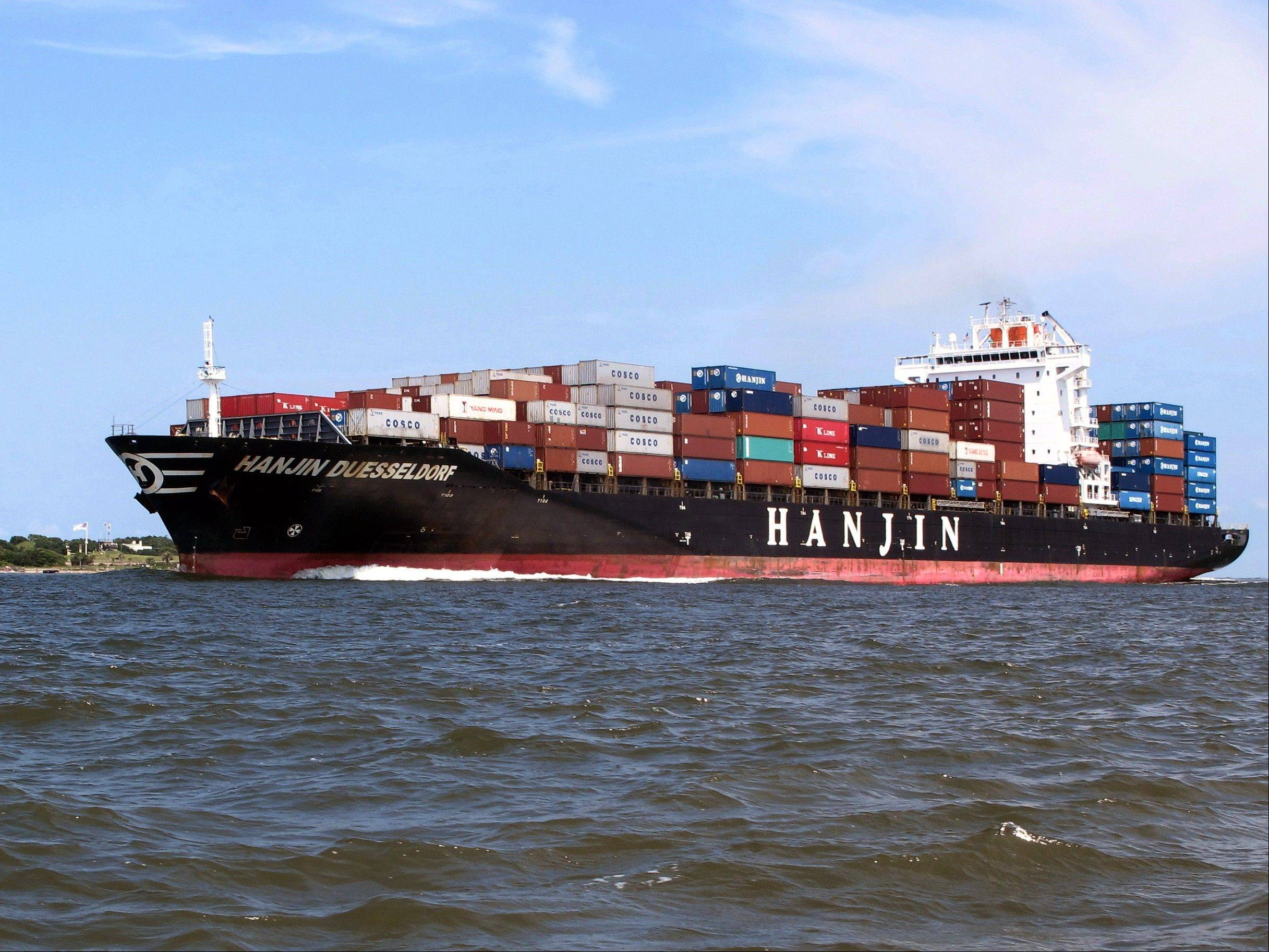 A container ship moves into the harbor in Charleston, S.C. The government reported Friday that wholesale prices rose 0.3 percent last month.