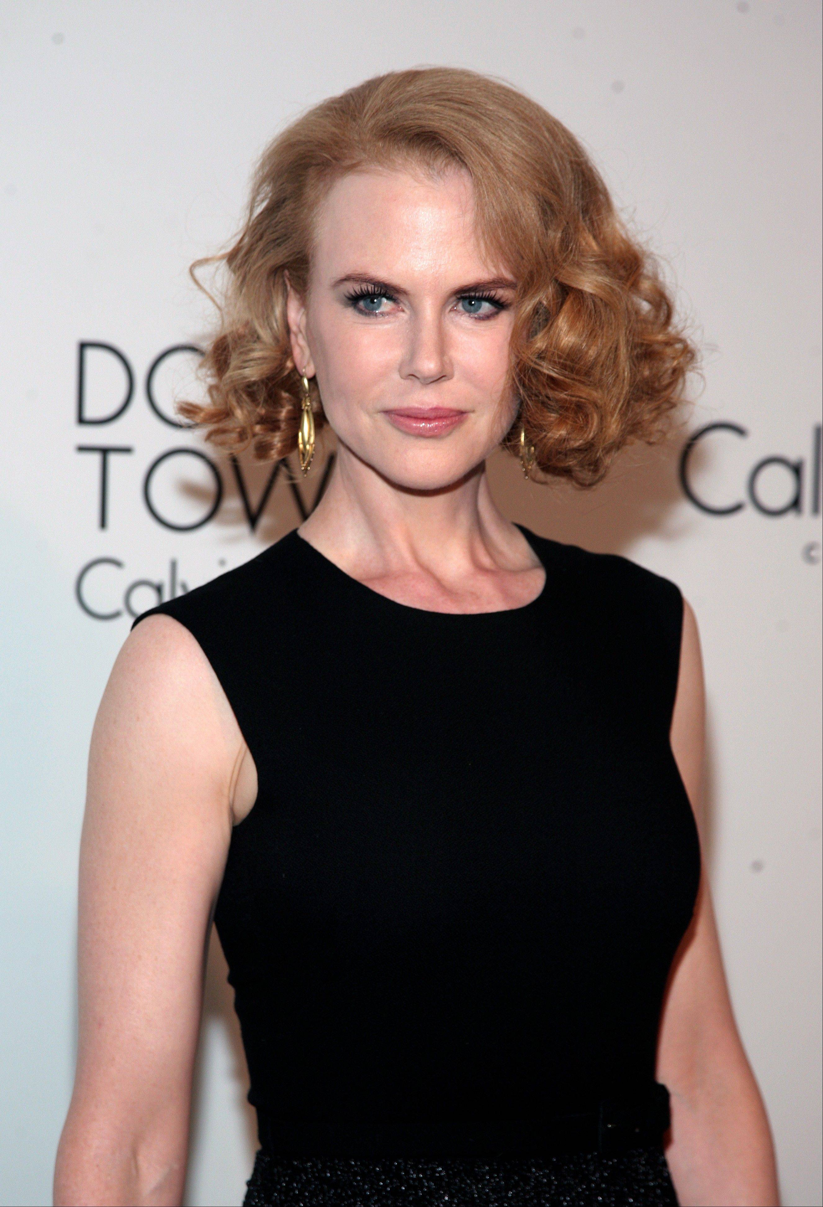 Nicole Kidman says she was shaken up after being knocked down by a bicyclist Thursday in New York.