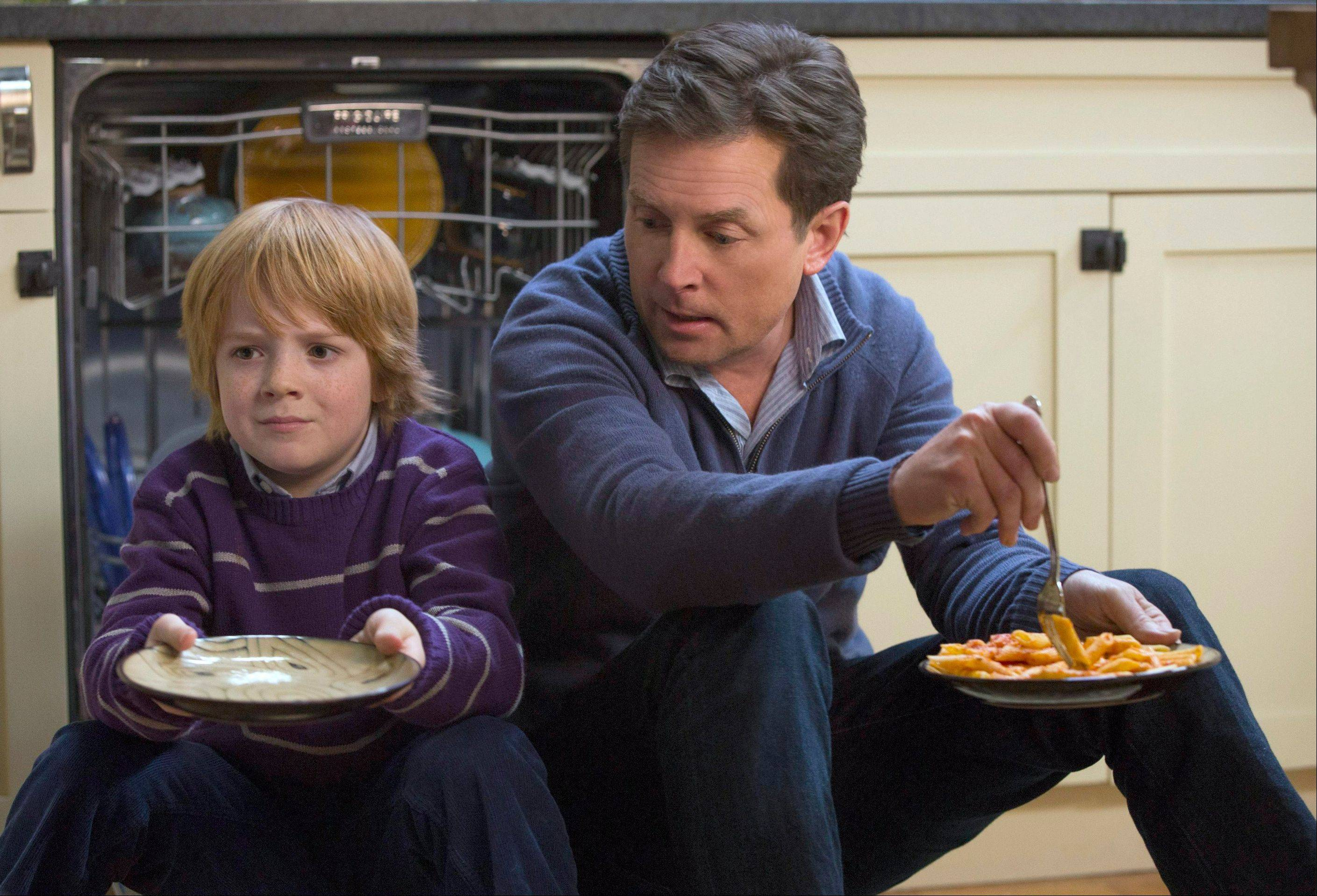 "Michael J. Fox returns to television in NBC's ""The Michael J. Fox Show,"" also starring Mike Henry."