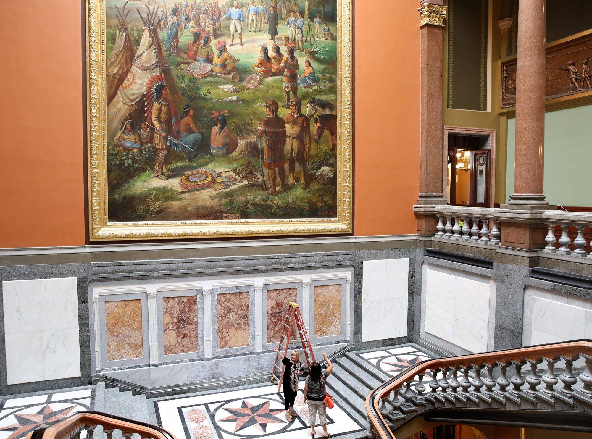 Mezzanine-level offices in the west wing of the state Capitol, which were entered through doors below the mural, have been eliminated as part of a two-year, $50 million renovation project.