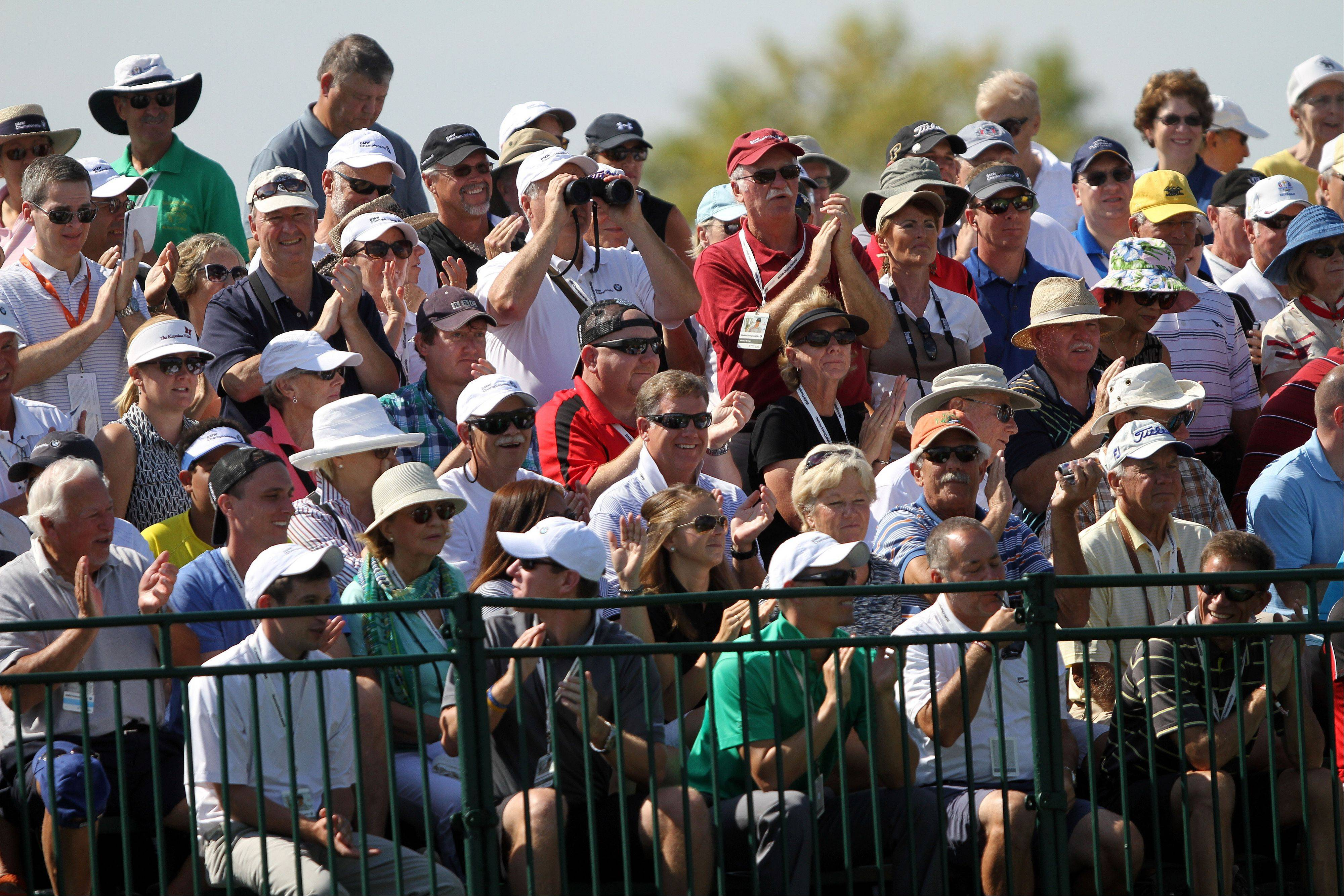 The crowd watches on the 12th hole during the first-round of the BMW Championship at Conway Farms Golf Club in Lake Forest Thursday.