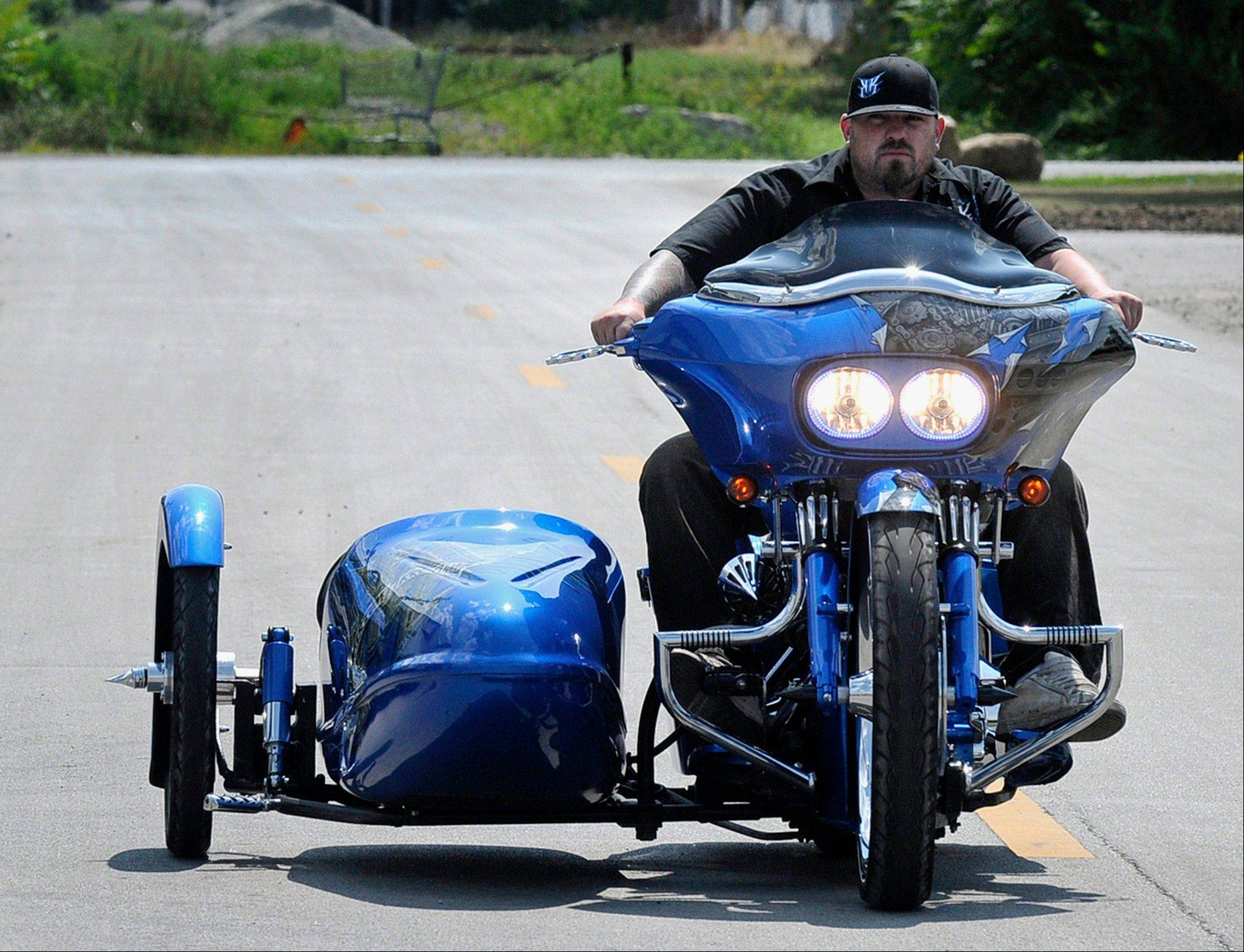 Artist Keith Kibbons rides his 2004 Harley-Davidson Road Glide in Kankakee. Kibbons customized and added a side car to the motorcycle after hitting a deer.