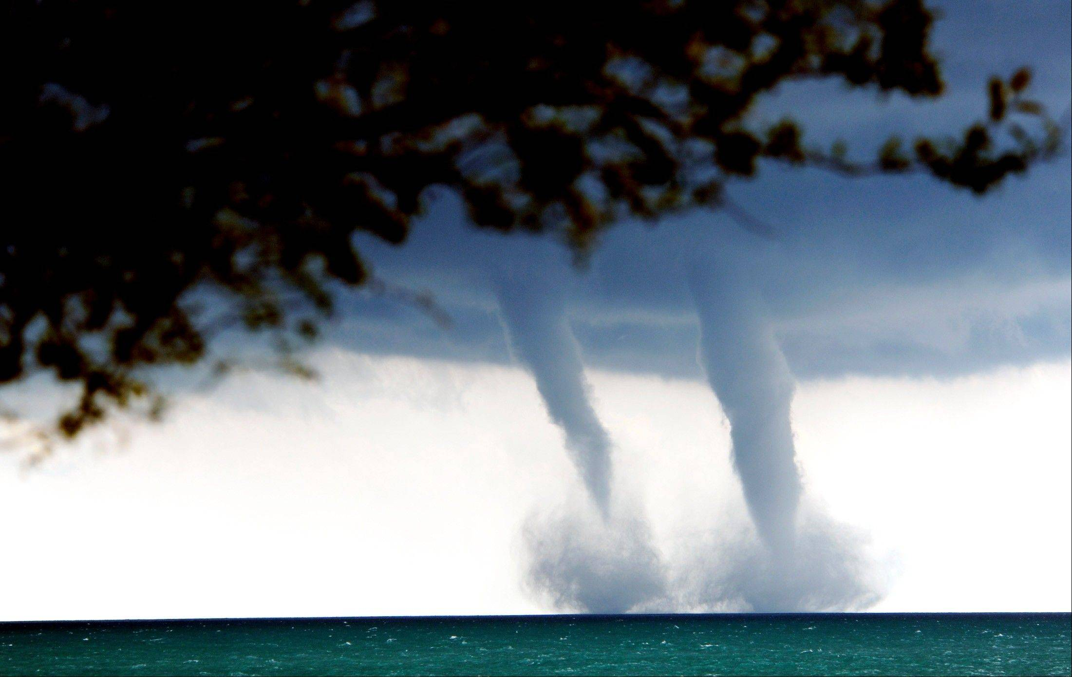 A pair of waterspouts were seen from downtown Waukegan and other lakefront suburbs Thursday. While waterspouts are basically tornadoes over water, they were no threat to land-dwellers.