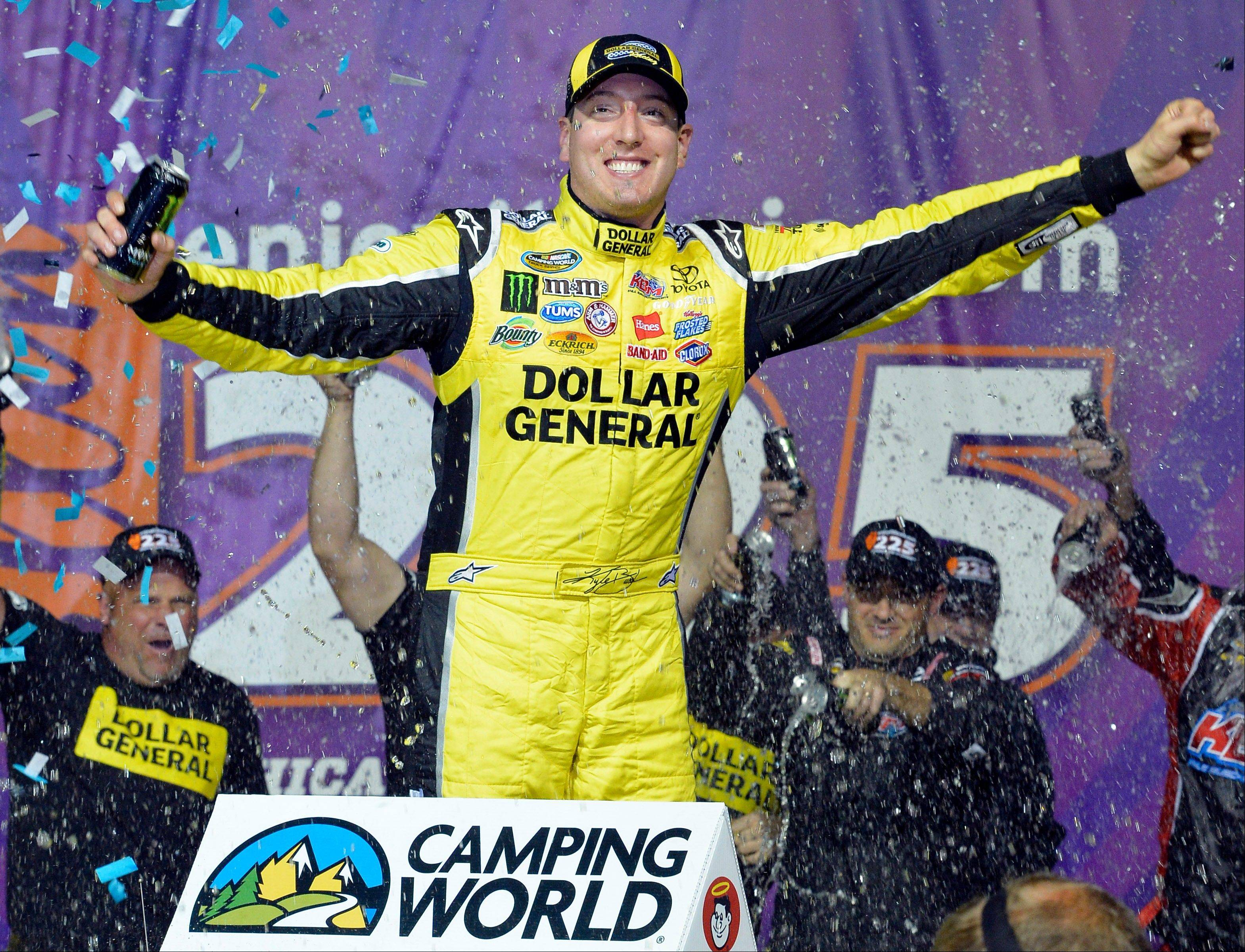 Kyle Busch celebrates winning the NASCAR Truck Series auto race Friday night at Chicagoland Speedway in Joliet