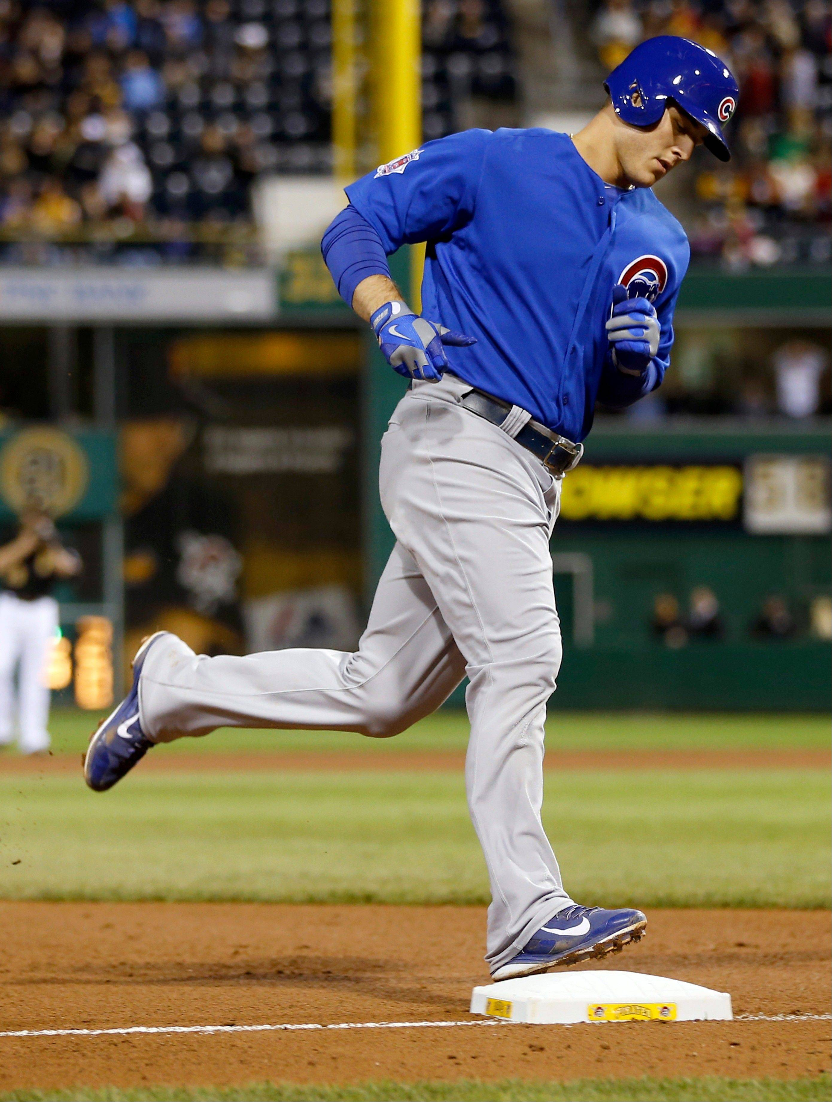 Chicago Cubs' Anthony Rizzo hits third as he rounds the bases after hitting a two-run home run against the Pittsburgh Pirates in the seventh inning of the baseball game on Friday, Sept. 13, 2013, in Pittsburgh. The Cubs won 5-4. (AP Photo/Keith Srakocic)
