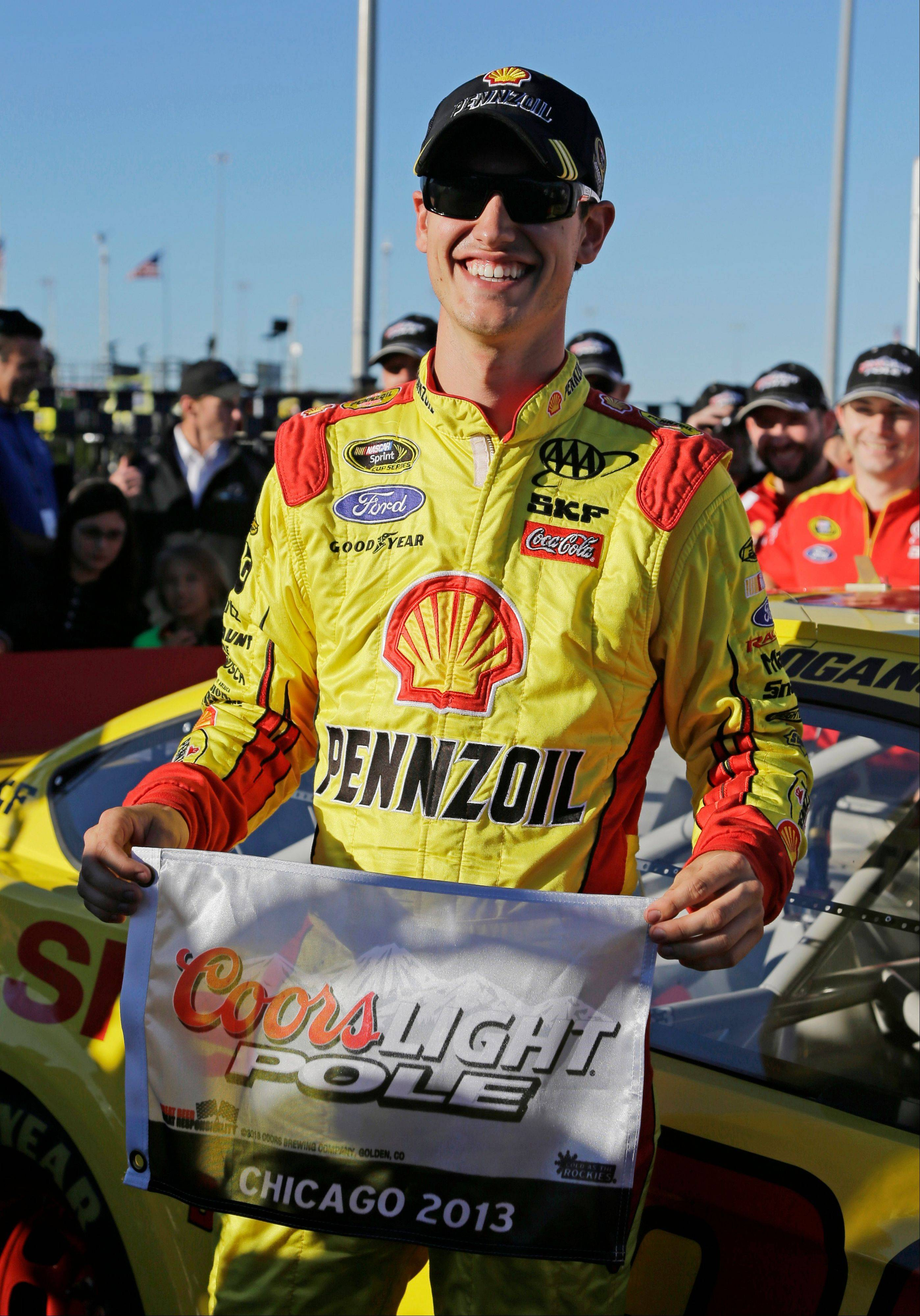 Joey Logano smiles after winning the pole during Friday's qualifying for the Geico 400 auto race Sunday at Chicagoland Speedway in Joliet