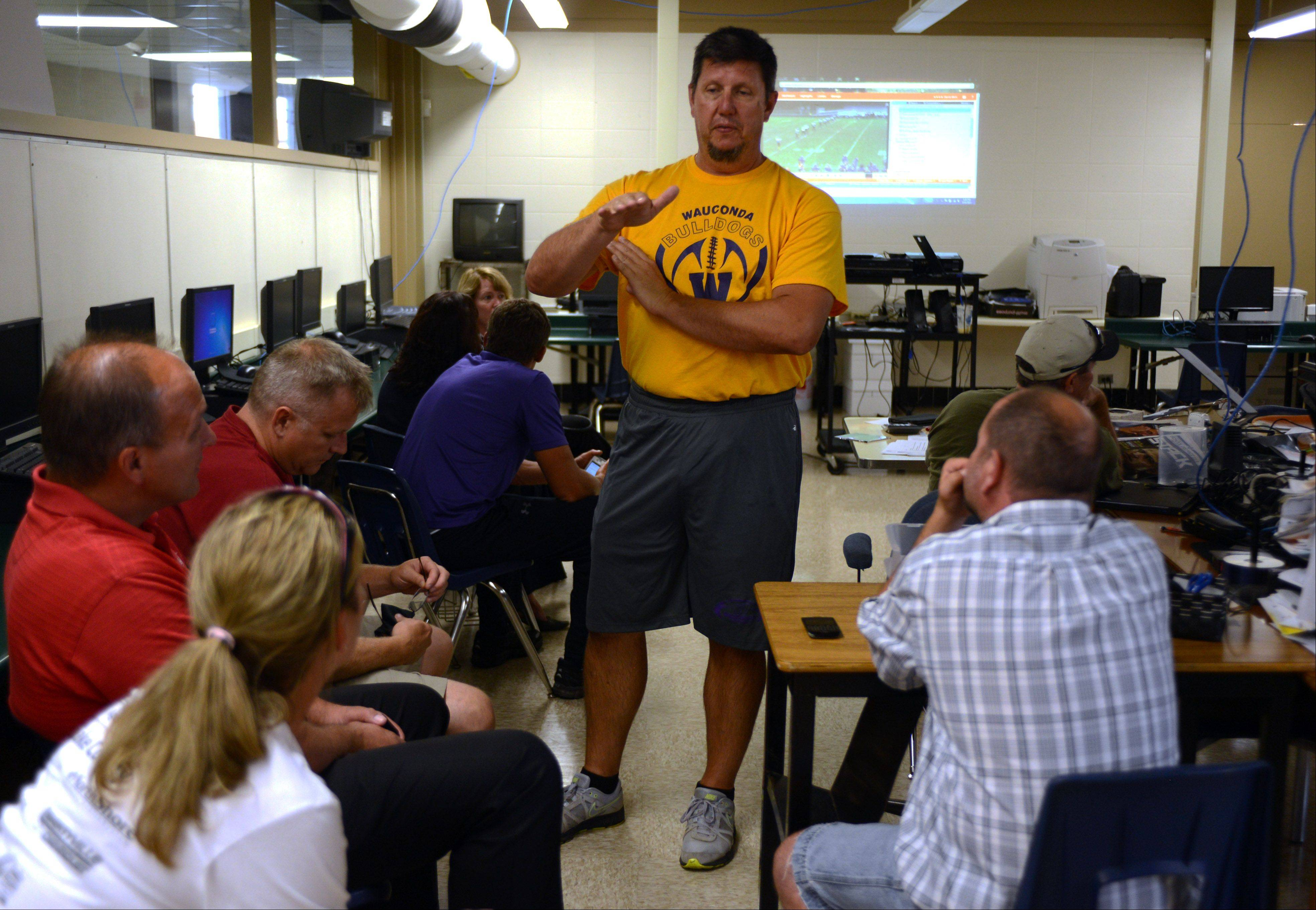 Wauconda coach Dave Mills talks to players' parents before Tuesday night's practice at the school.