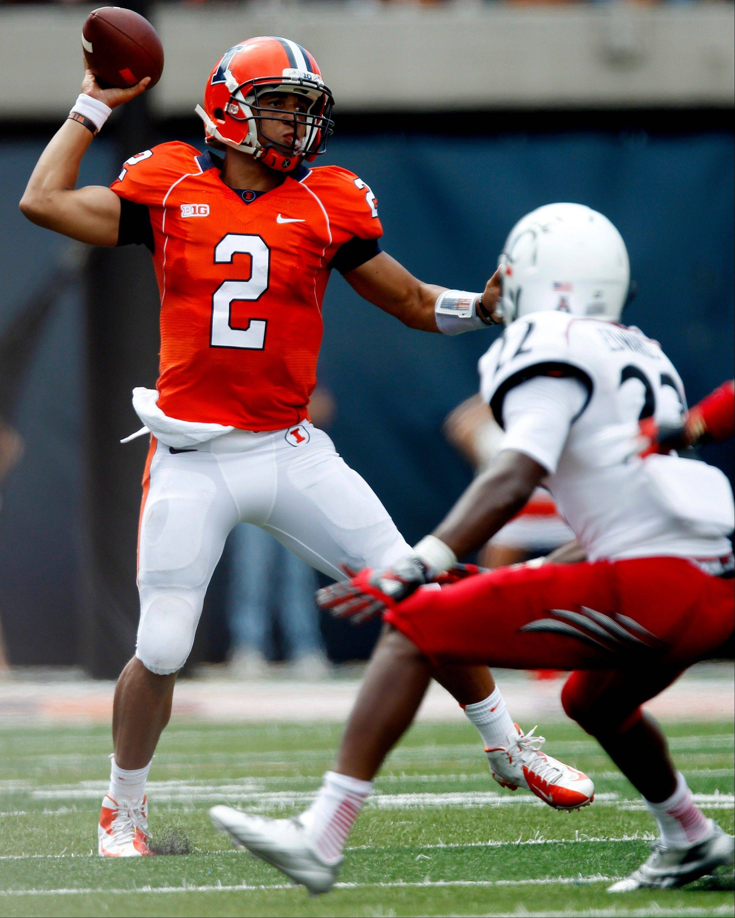 Illinois quarterback Nathan Scheelhaase throws past Cincinnati safety Zach Edwards during last week's game in Champaign. Scheelhaase is off to his best start in his four seasons as a starter at Illinois.