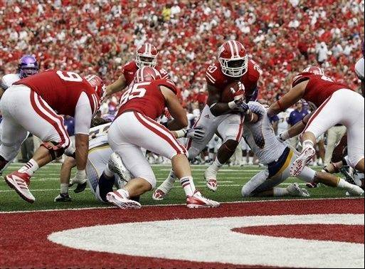 Wisconsin's James White runs for a touchdown against Tennessee Tech last Saturday in Madison, Wis. White has posted more than 100 yards rushing in both of the Badgers' first two games.