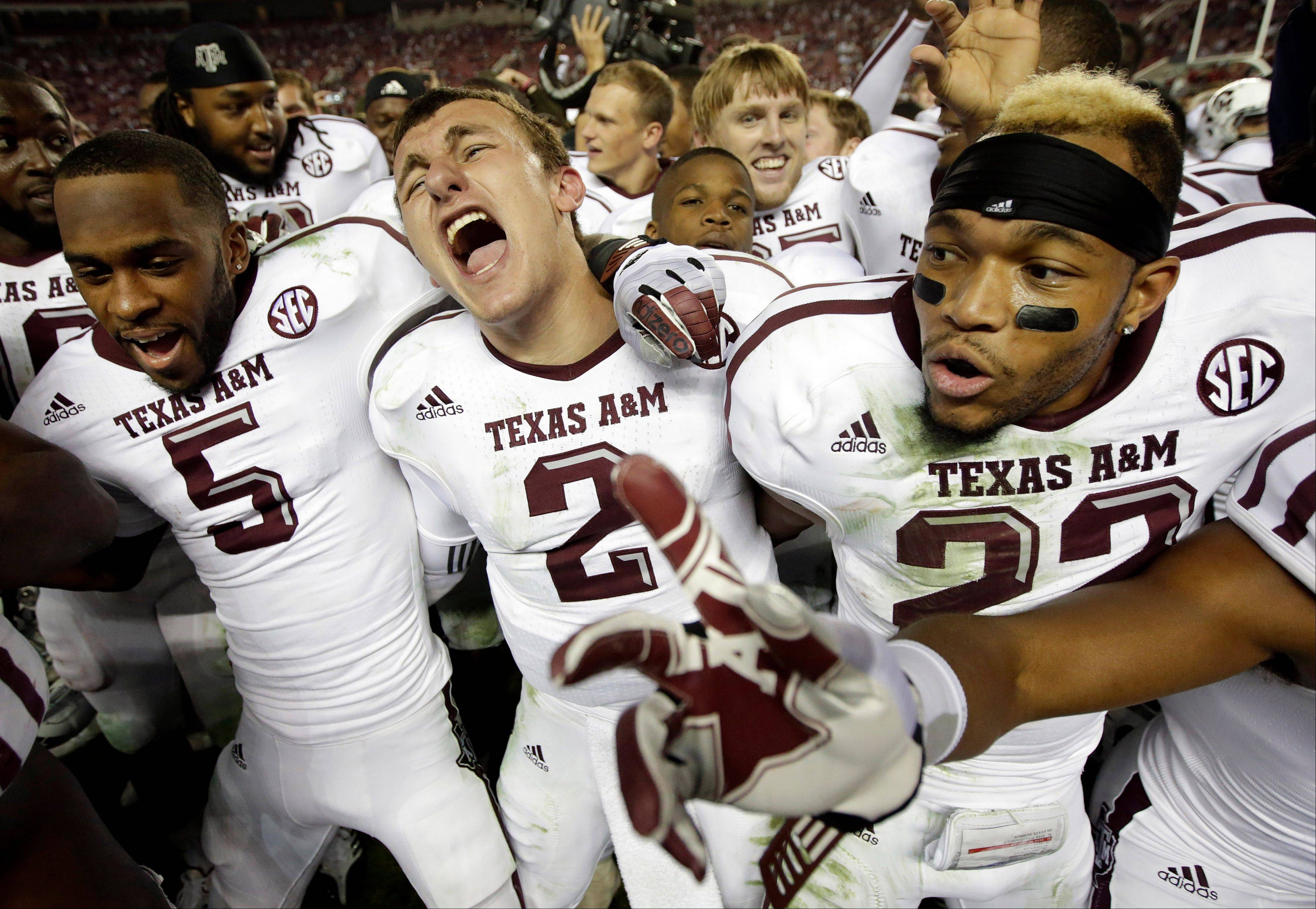 Texas A&M quarterback Johnny Manziel (2) was excited after leading his team to an upset over Alabama last November. The two teams meet again on Saturday.