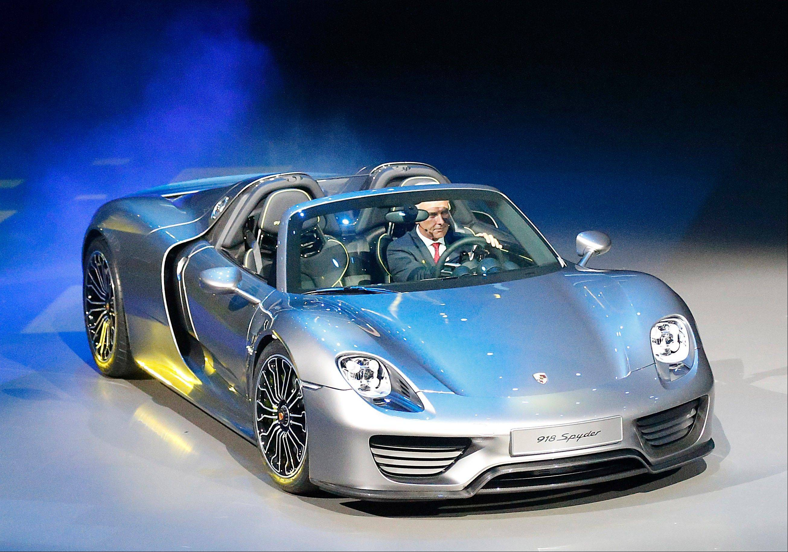 Porsche AG CEO Matthias Mueller steers the new Porsche 918 Spyder during a preview by the Volkswagen Group prior to the 65th Frankfurt Auto Show in Frankfurt, Germany.
