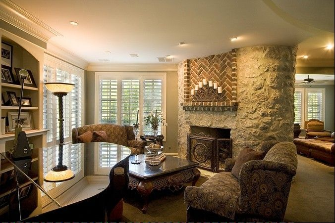 This two-sided fireplace built by Shodeen Homes can be enjoyed in two rooms.