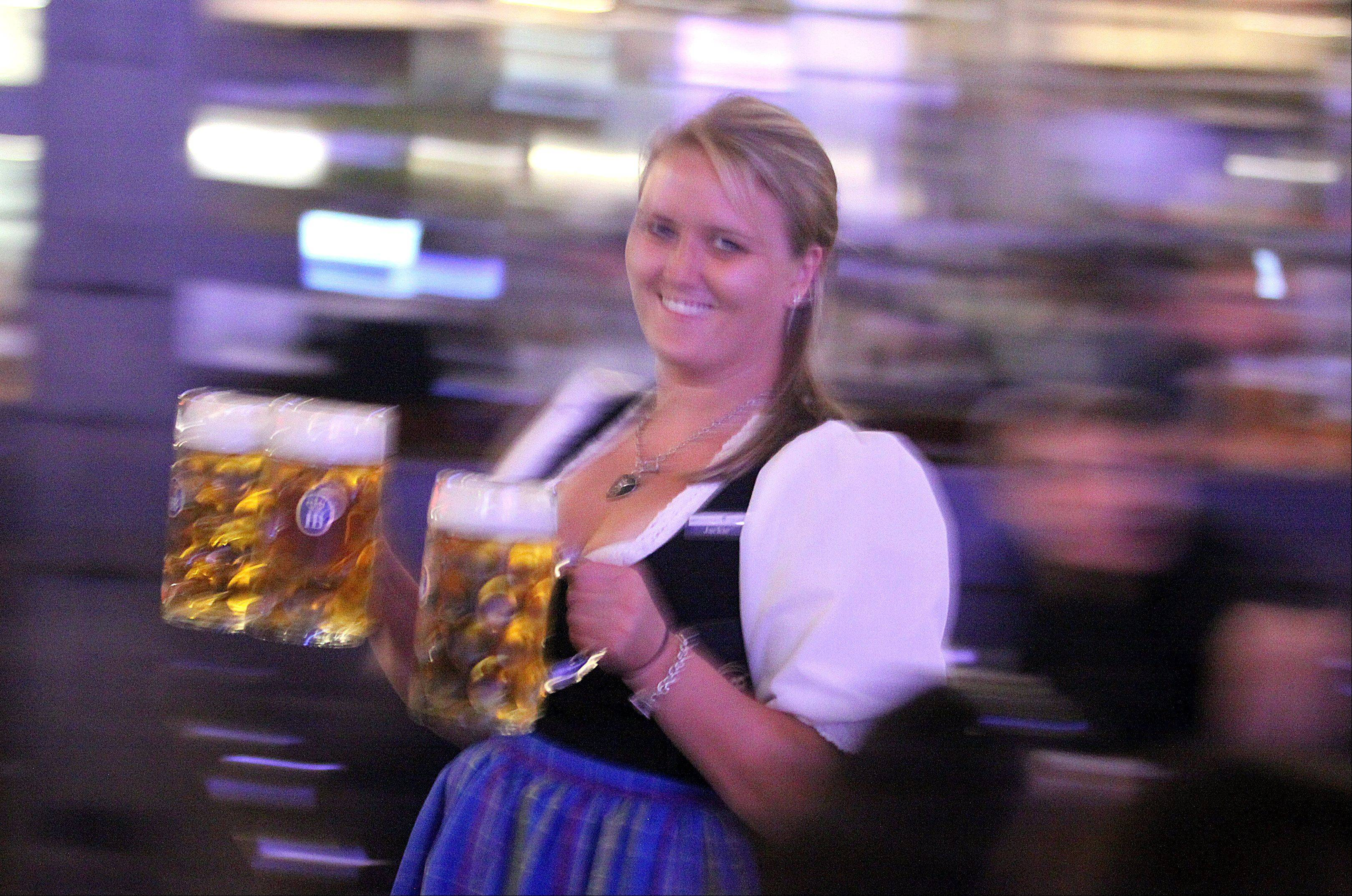 Server Jackie Majesty delivers liters of lager at the Hofbräuhaus Chicago restaurant in Rosemont.