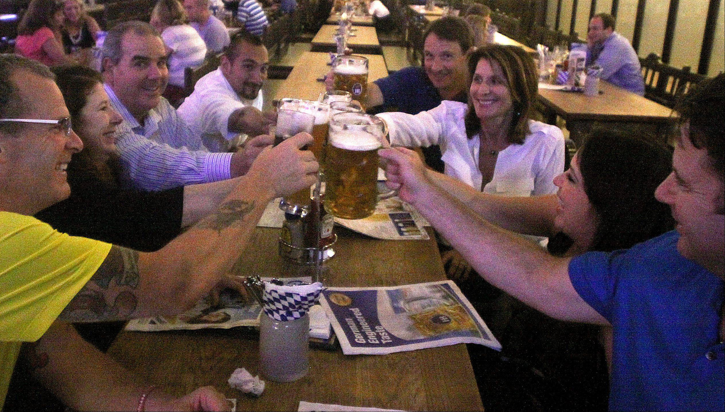 A group of patrons share a toast with their steins of beer at Hofbräuhaus Chicago. The Rosemont restaurant is celebrating Oktoberfest through the end of October.