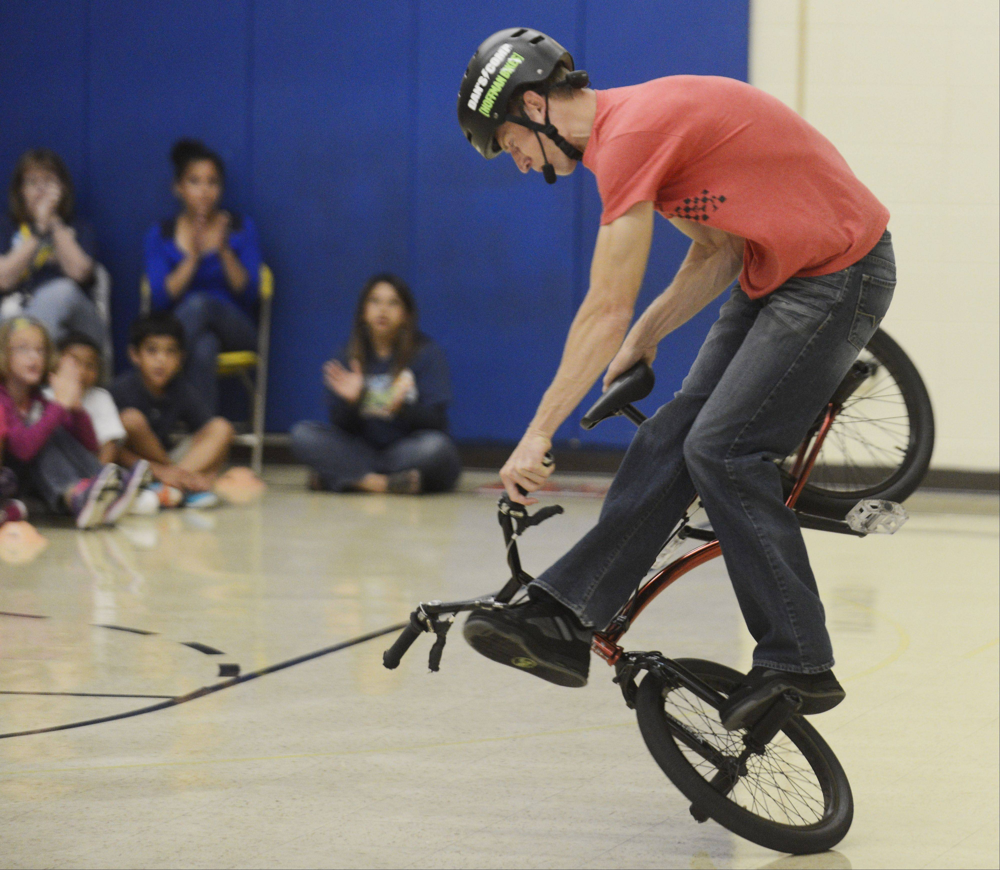 America's Got Talent semifinalist Matt Wilhelm performs stunts on his BMX bike for an assembly at Horizon Elementary School in Hanover Park, while talking to the students about bullying, perseverance, bike safety and character.