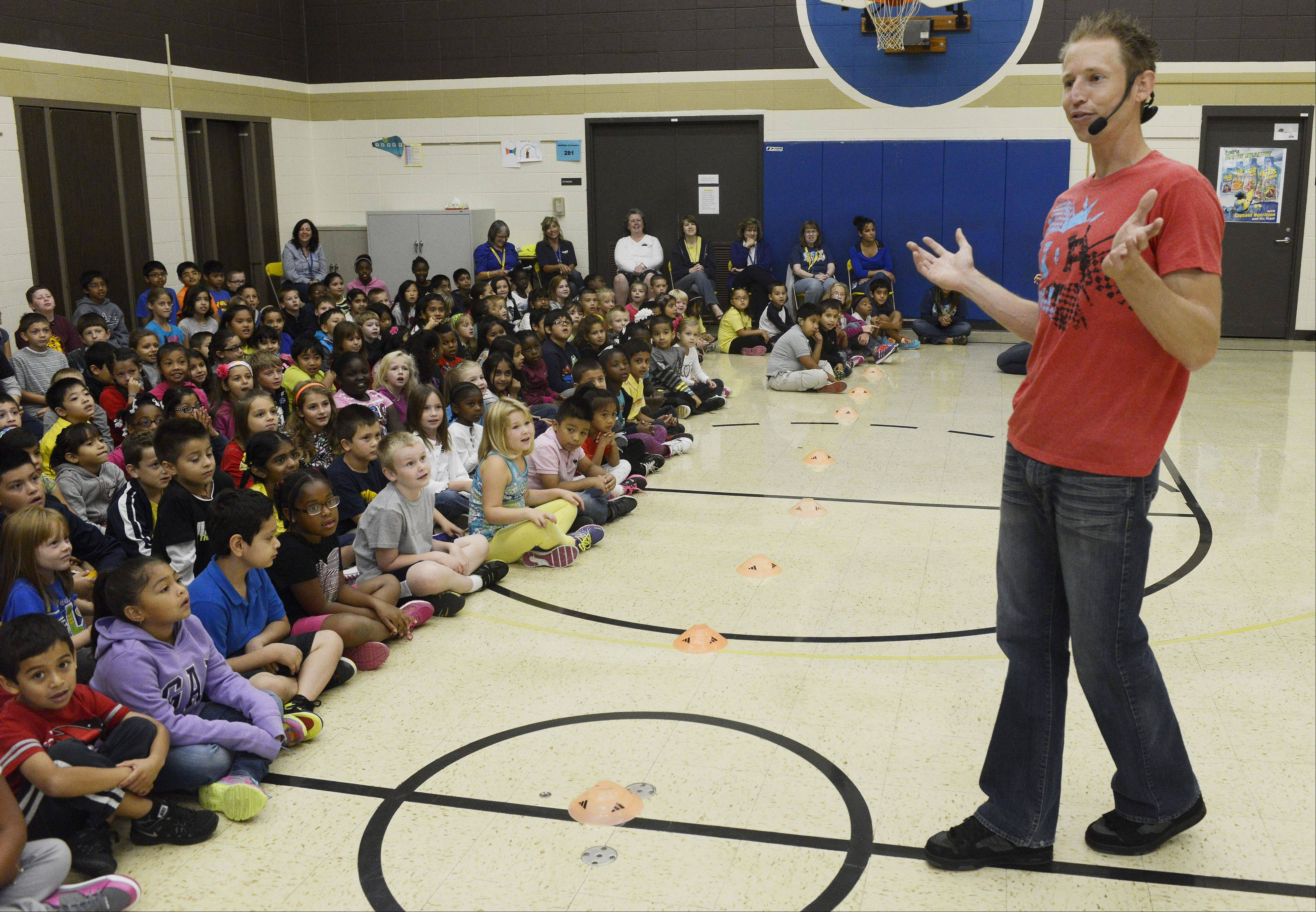 JOE LEWNARD/jlewnard@dailyherald.comDuring a break between BMX bike stunts, America's Got Talent semifinalist Matt Wilhelm talks to students at Horizon Elementary School in Hanover Park about bullying, perseverance, bike safety and character.