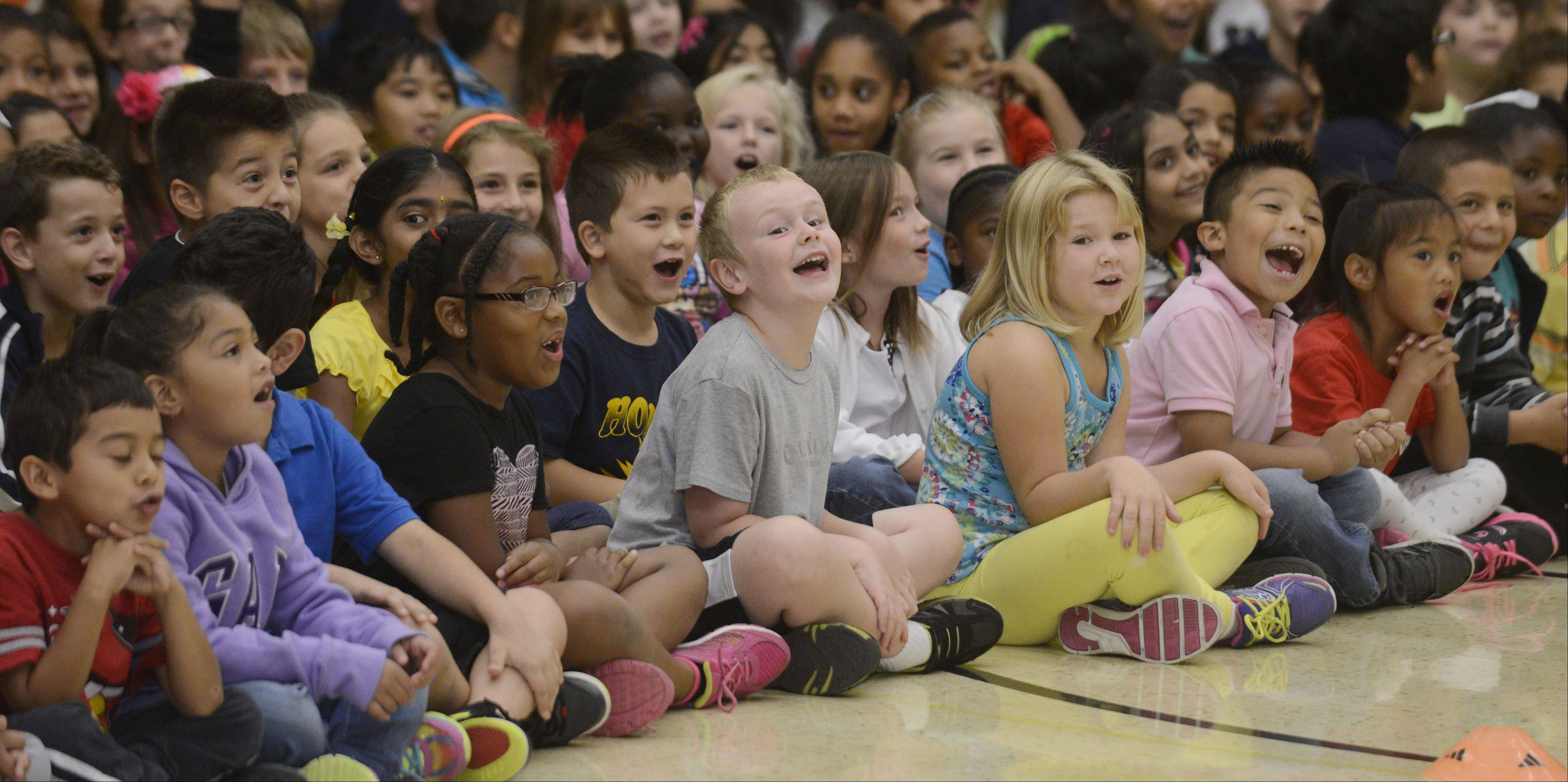 JOE LEWNARD/jlewnard@dailyherald.comStudents watch as America's Got Talent semifinalist Matt Wilhelm performs stunts on his BMX bike for an assembly at Horizon Elementary school in Hanover Park. In addition to performing the stunts, Wilhelm talked to the students about bullying, perseverance, bike safety and character.