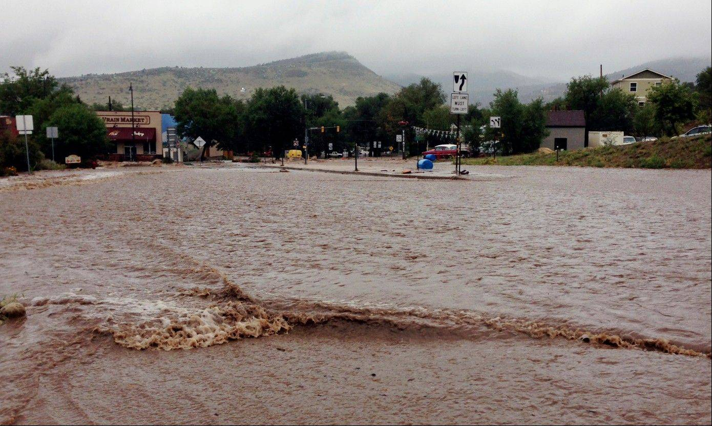 This image provided by Jason Stillman, shows flooding in Lyons Colo., Thursday Sept. 12, 2013. Boulder County Sheriff Joe Pelle said the town of Lyons was completely cut off because of flooded roads. Flash flooding in Colorado has cut off access to towns, closed the University of Colorado in Boulder and left at least three people dead.