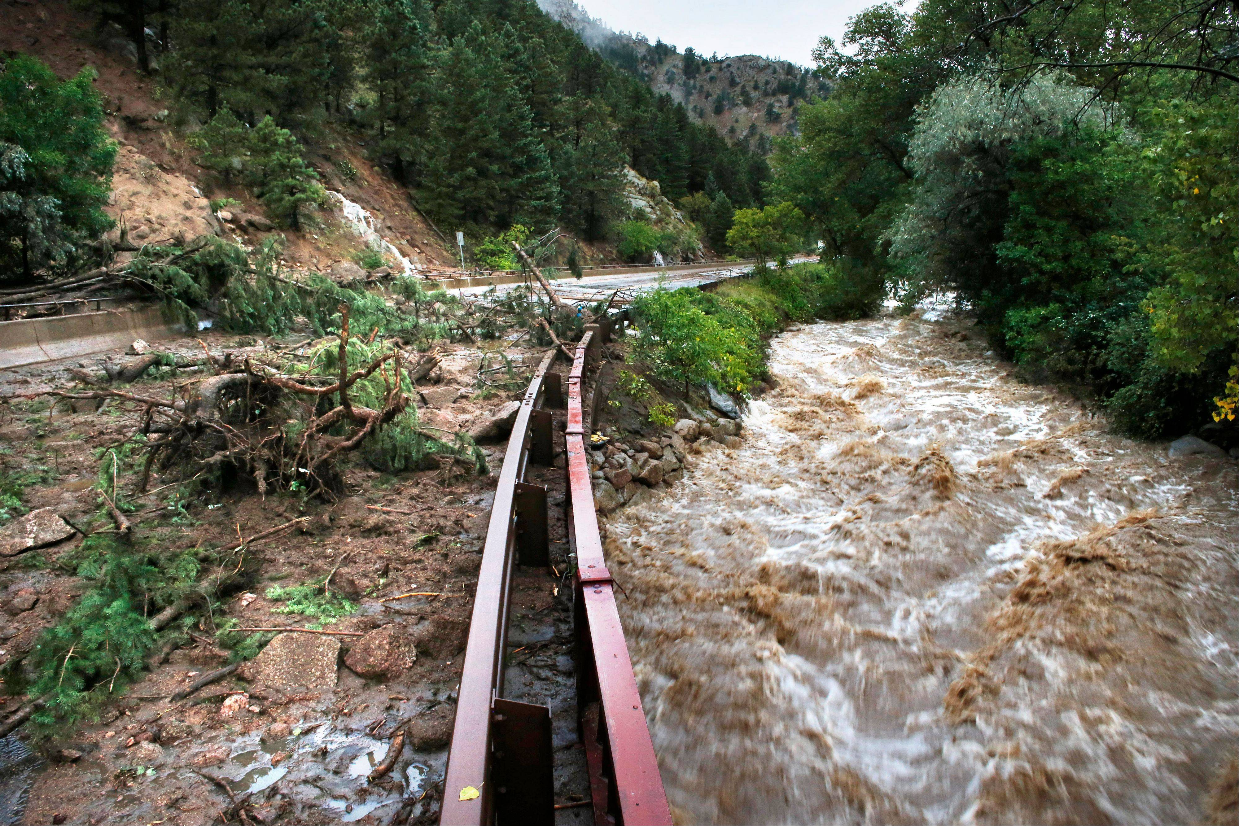 Boulder Creek flows at high speed next to a road closed off by debris from days of rain and flooding, at the base of Boulder Canyon, Colo., Friday, Sept. 13, 2013. People in Boulder were ordered to evacuate as water rose to dangerous levels amid a storm system that has been dropping rain for a week. Rescuers struggled to reach dozens of people cut off by flooding in mountain communities, while residents in the Denver area and other areas were warned to stay off flooded streets.