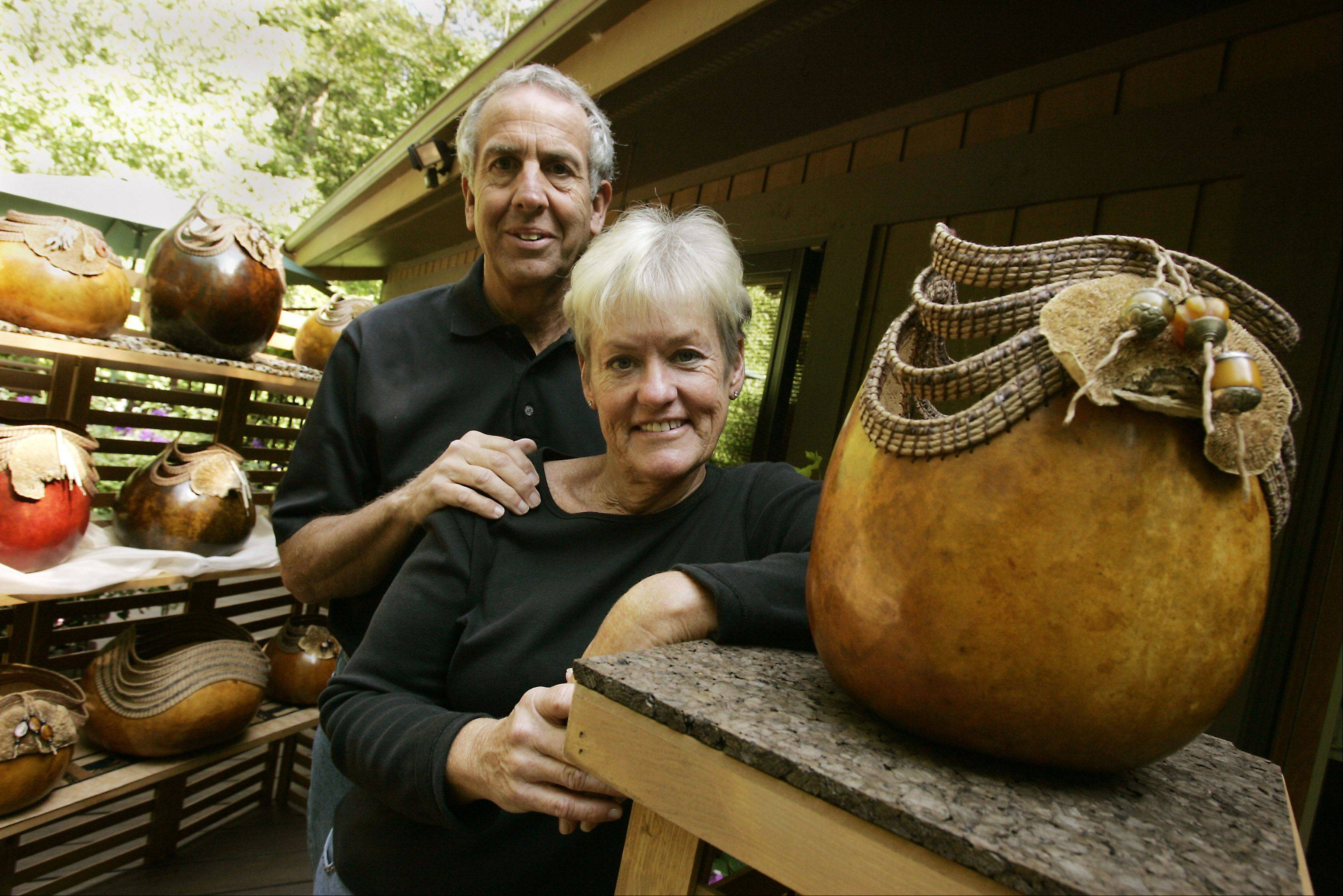 Rosie and Dave Claus of Naperville will bring their unique gourd creations to the Naperville Art League's annual Riverwalk Fine Art Fair. Dave prepares the surfaces of the gourds and does pyro-engraving to burn in designs, while Rosie does the weaving and coiling.