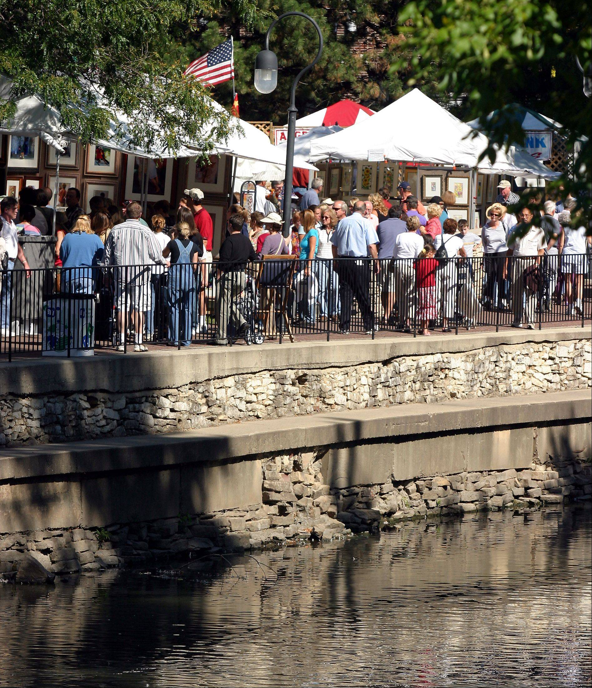The Naperville Riverwalk setting helps create an ambience for the Riverwalk Fine Art Fair that draws both artists and visitors.