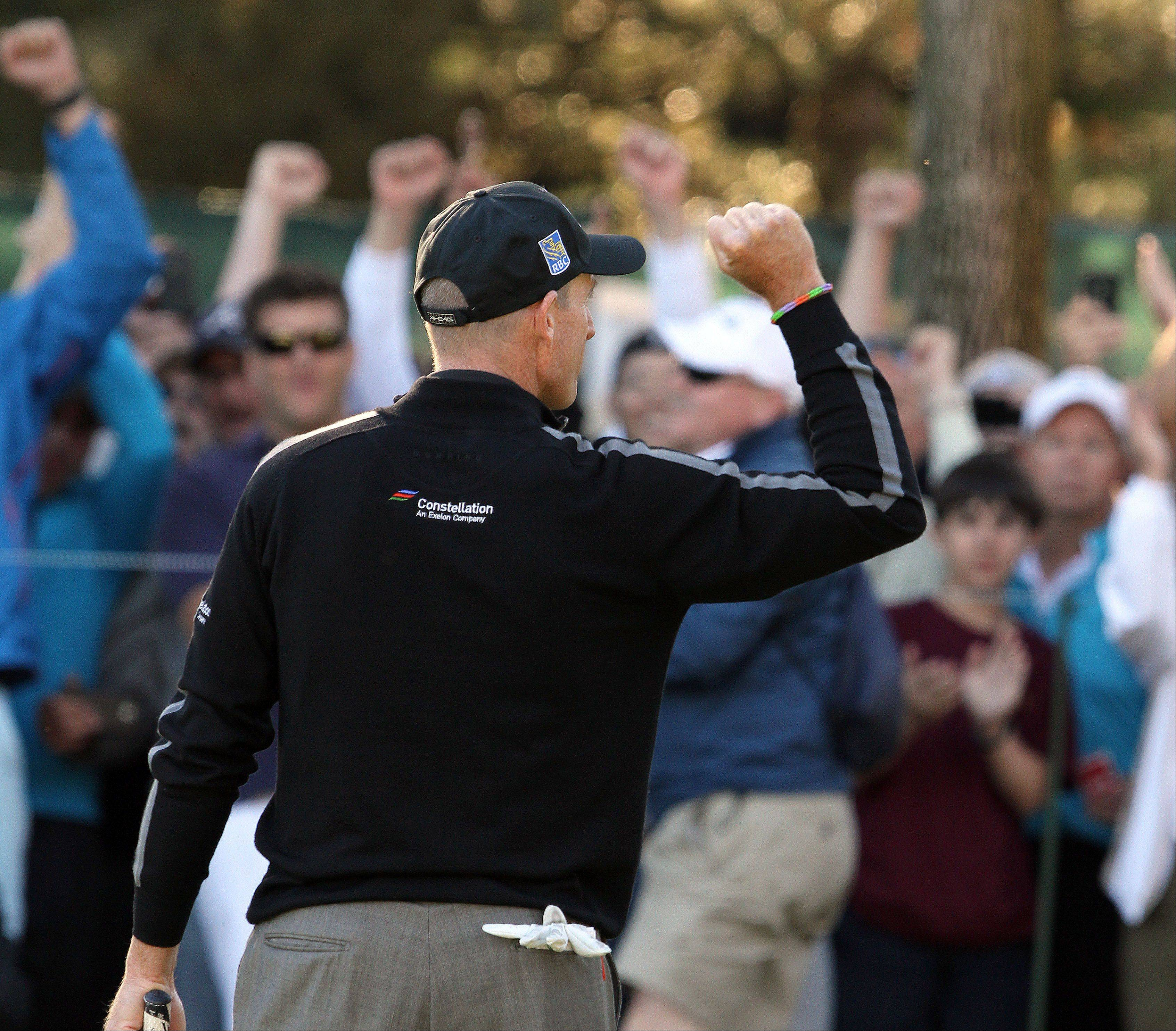 Jim Furyk gestures to the crowd after his round of 59.