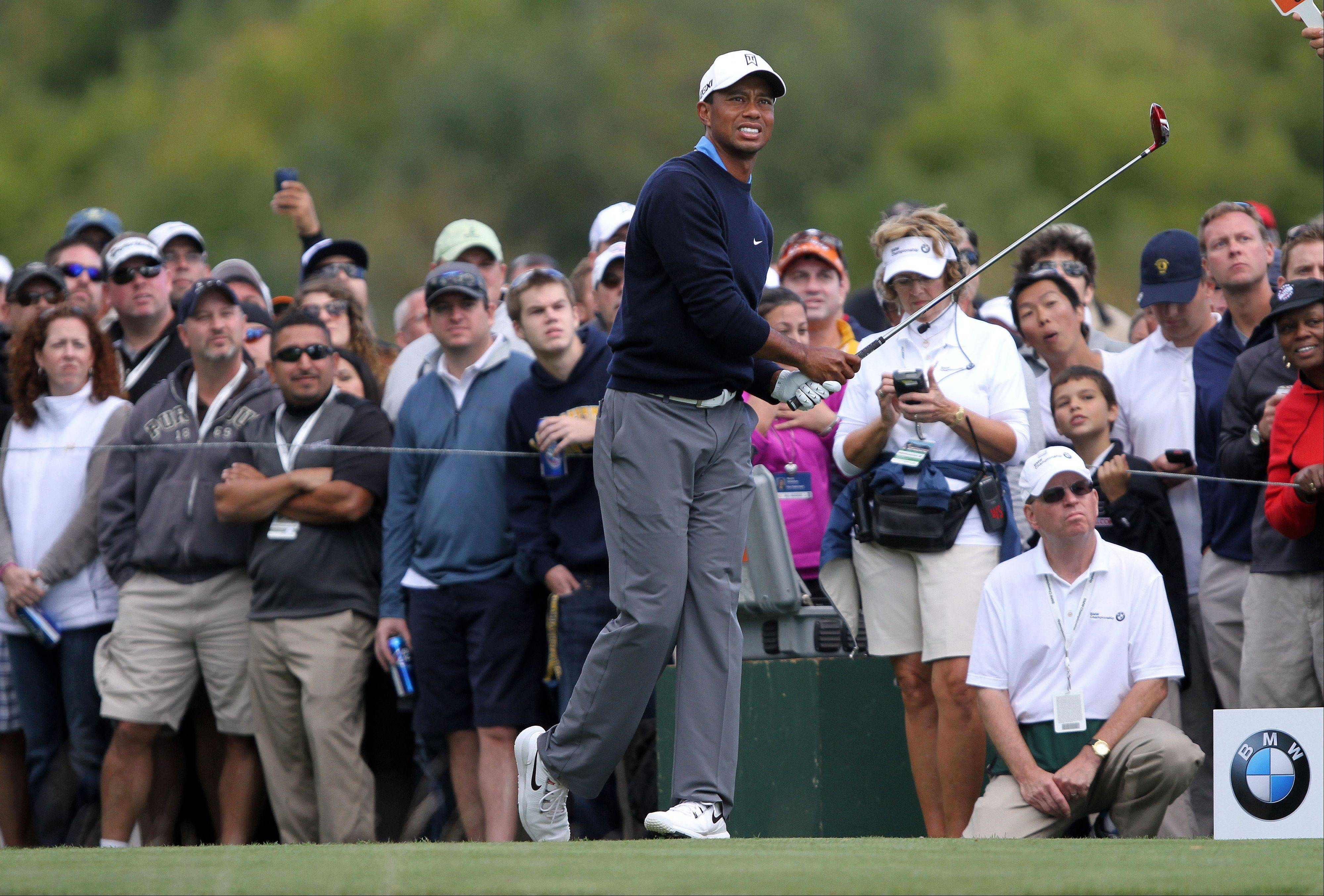 Tiger Woods watches his tee shot on the 8th hole.