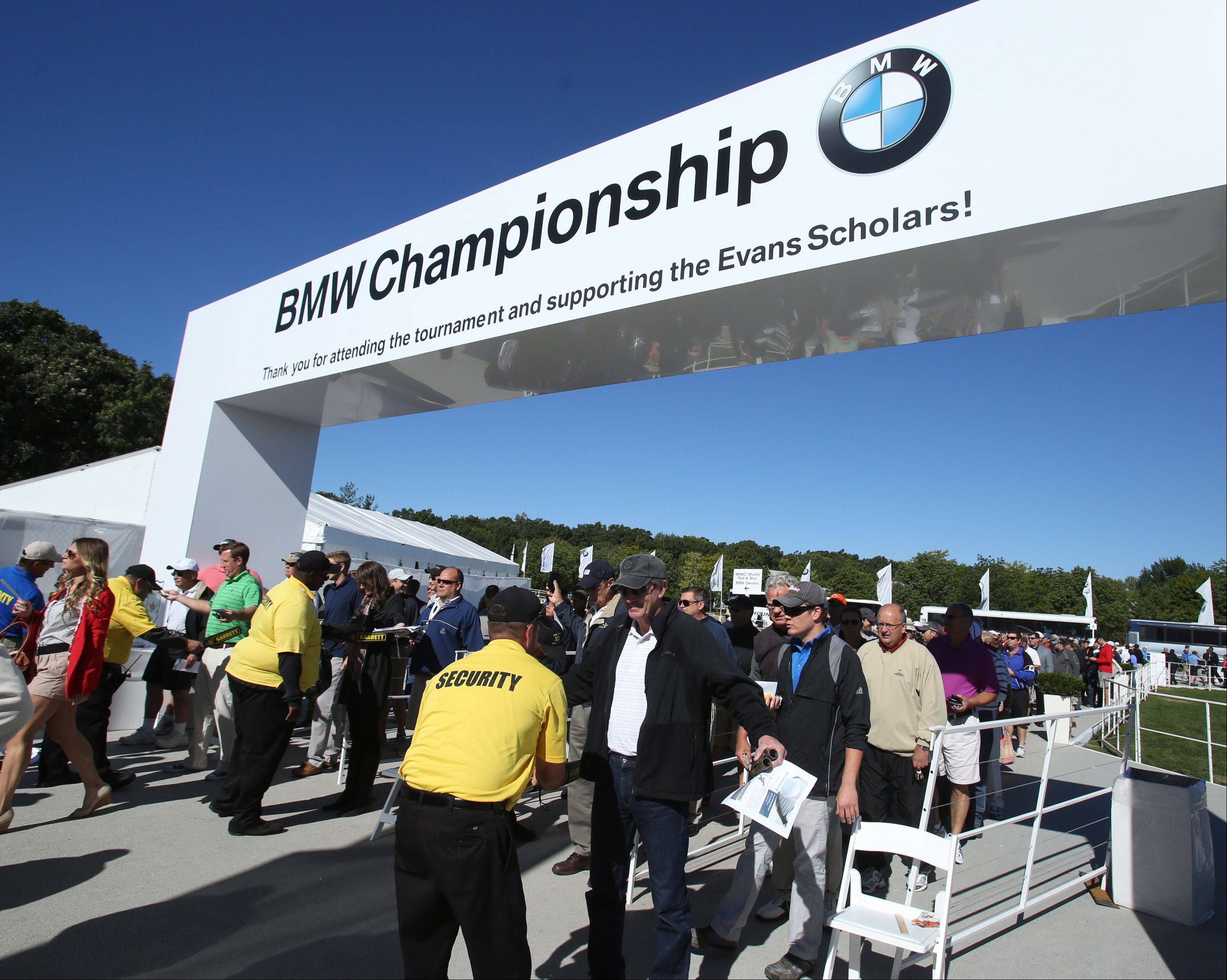 Fans arrive through the main entrance of the BMW Championship at Conway Farms Golf Club in Lake Forest on Friday.