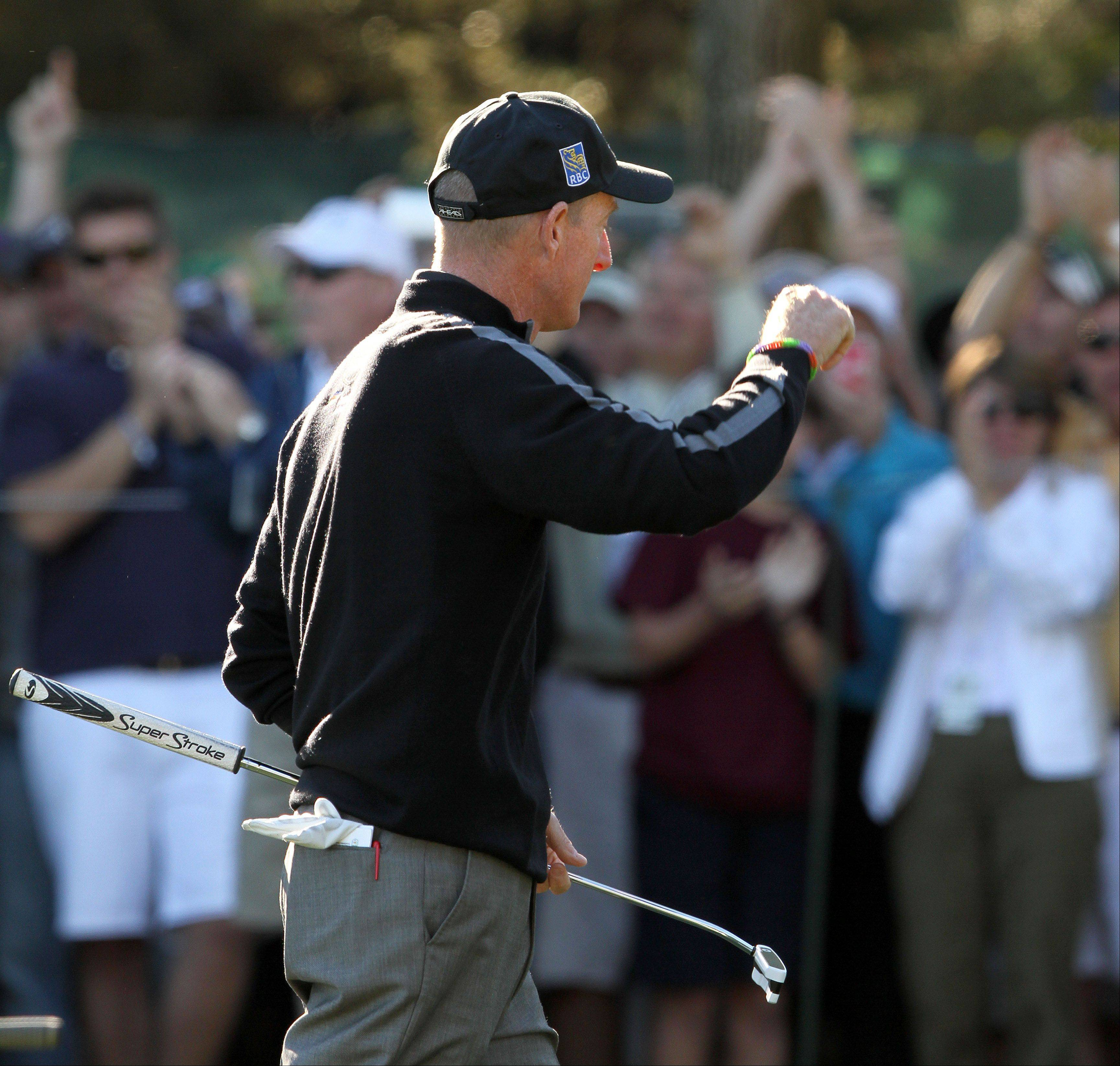 Jim Furyk gestures to the crowd after shooting his round of 59.
