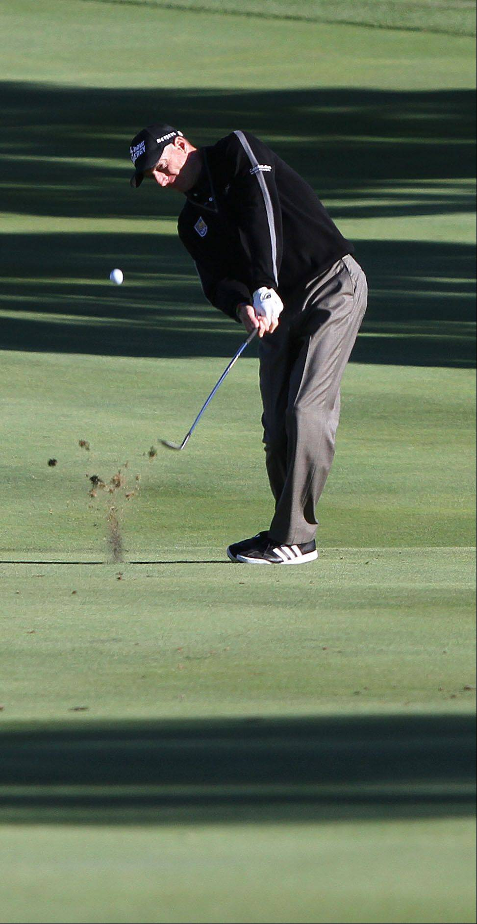 Jim Furyk hits his approach shot to the 9th hole.