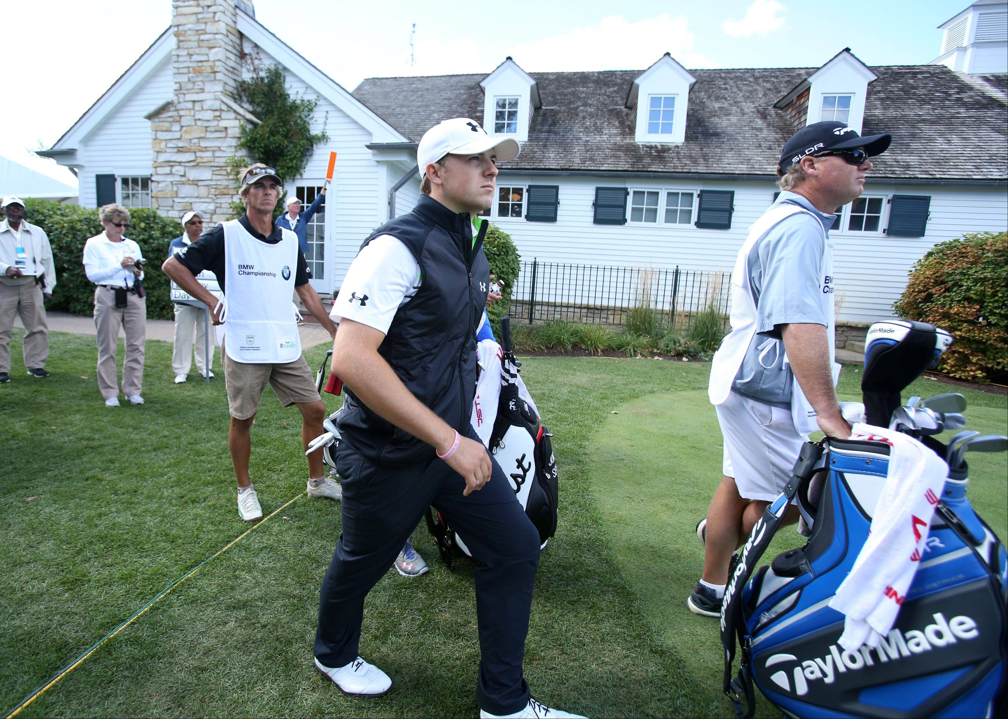 Jordan Spieth walks to the fairway after teeing off on the 3rd hole.