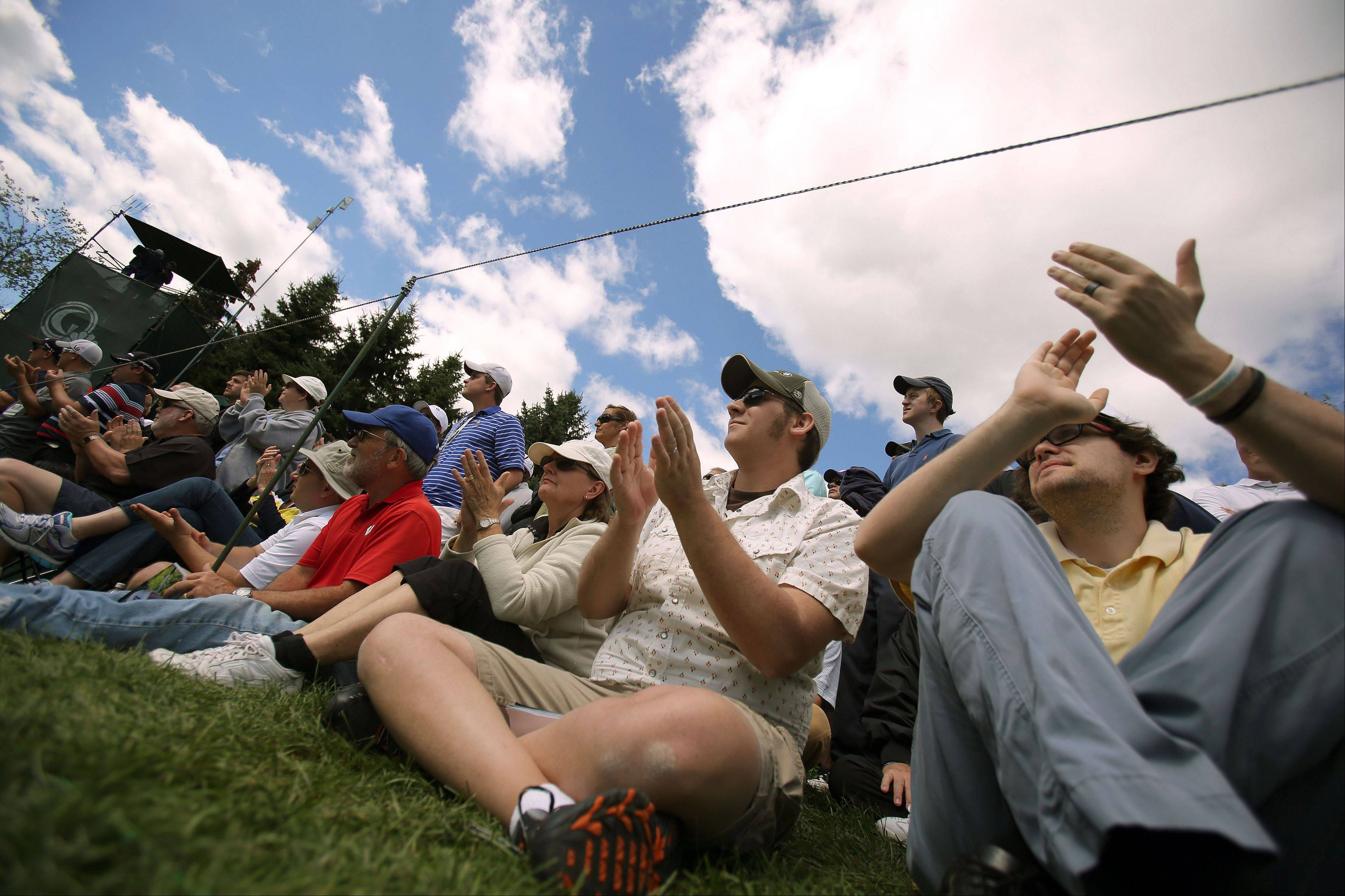 Fan cheer for Tiger Woods on the 7th green.