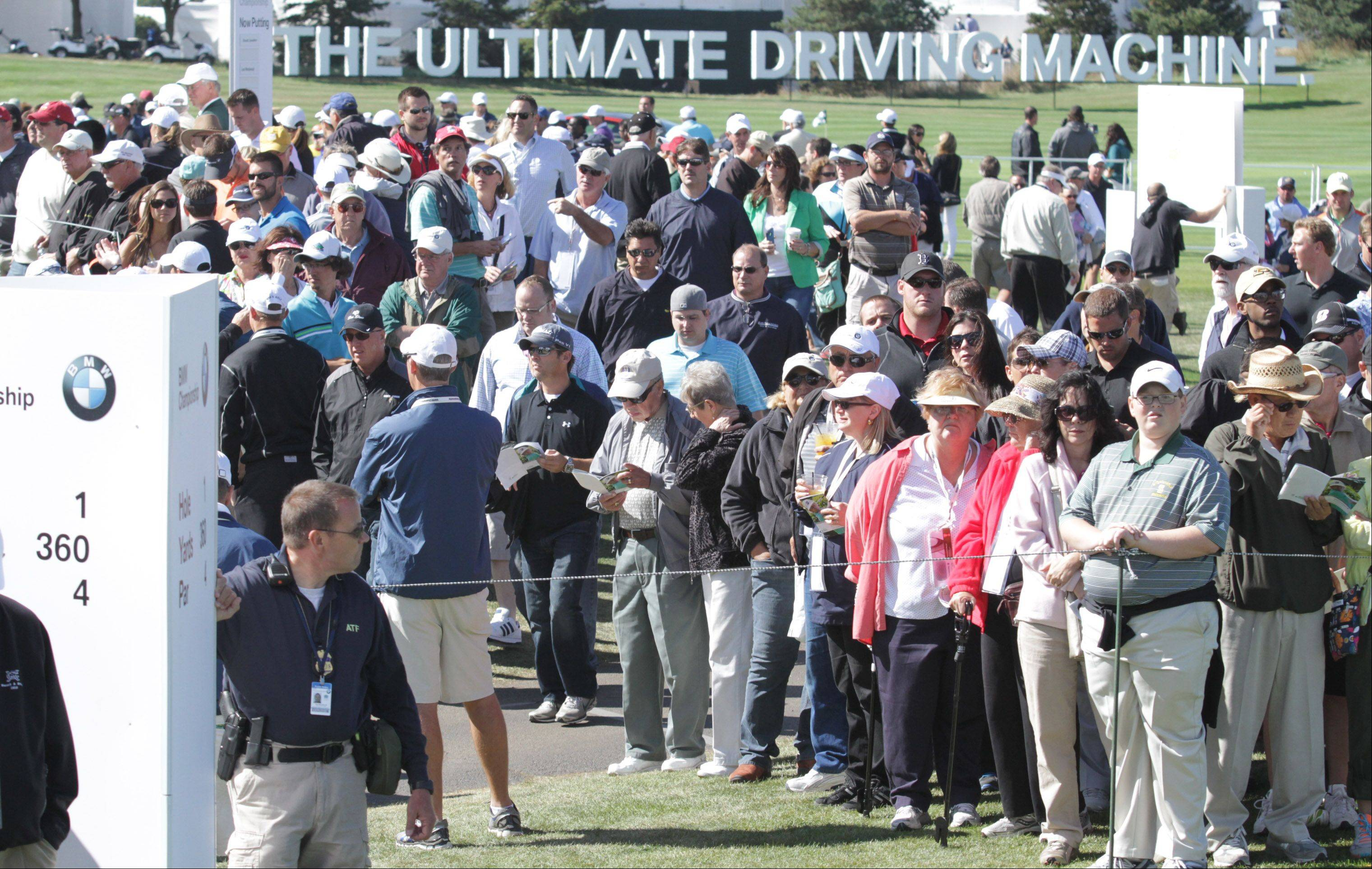 Fans watch Hunter Mahan tee off on the 1st hole.