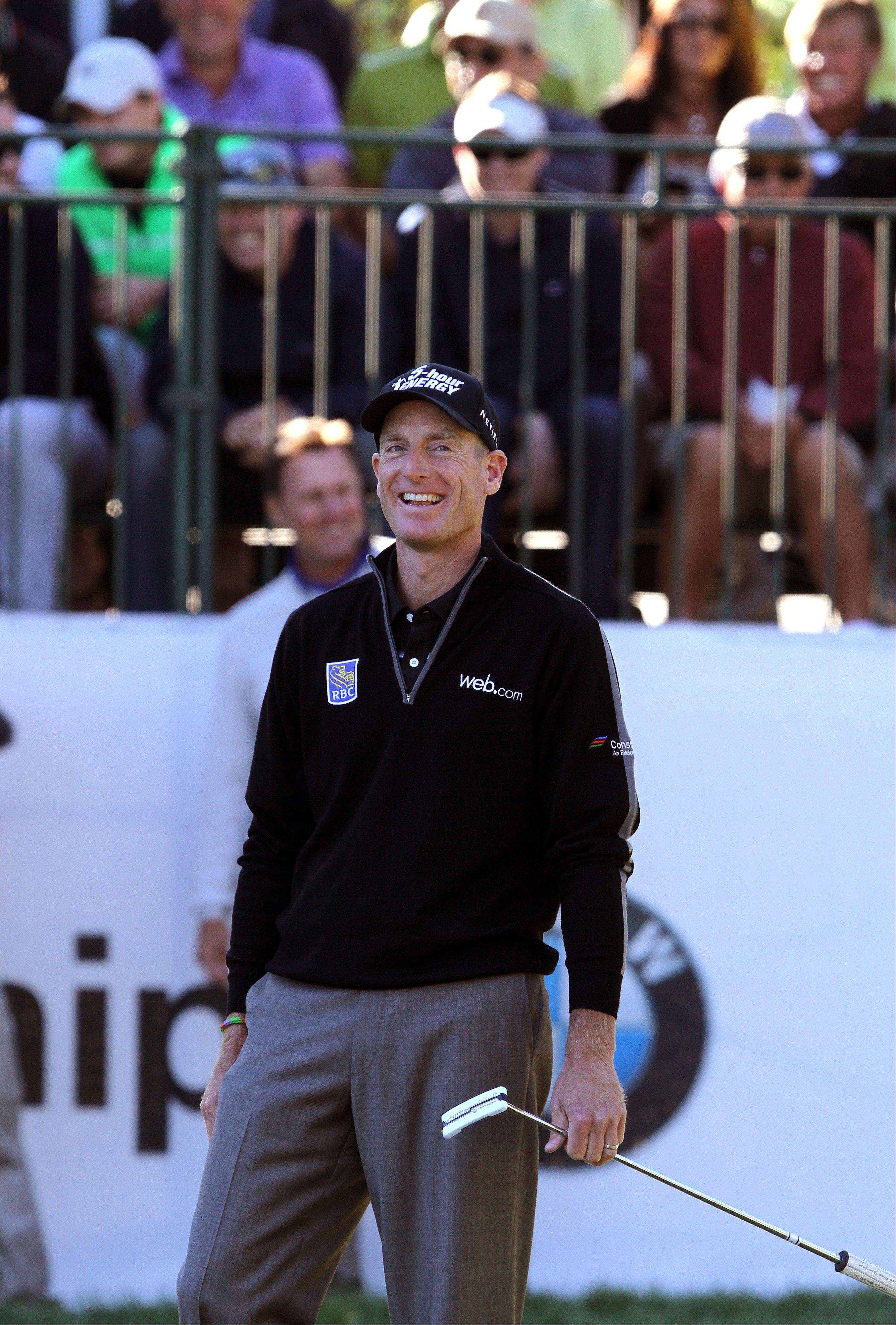 Jim Furyk smiles on the 9th hole after a fan shouted encouragement.