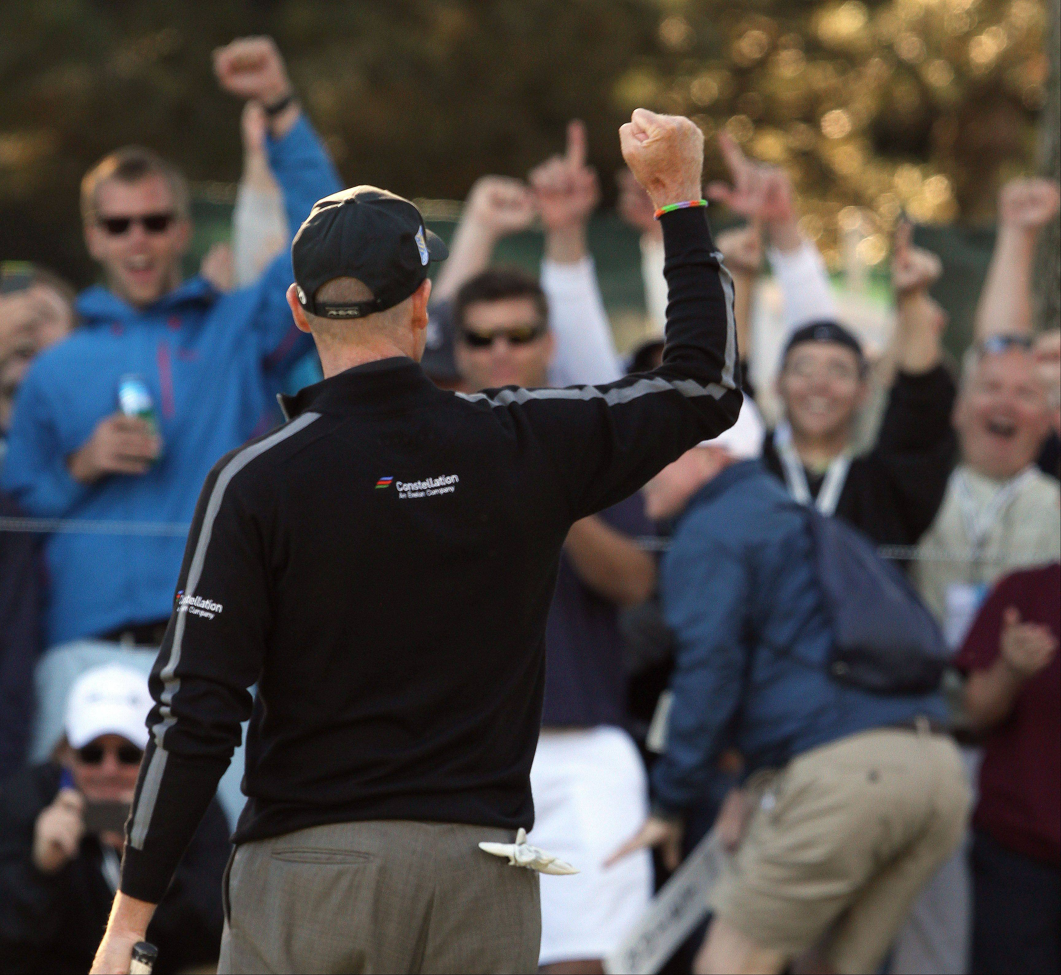 Steve Lundy/slundy@dailyherald.comJim Furyk gestures to the crowd after shooting 59 during the second-round of the BMW Championship at Conway Farms Golf Club in Lake Forest Friday.