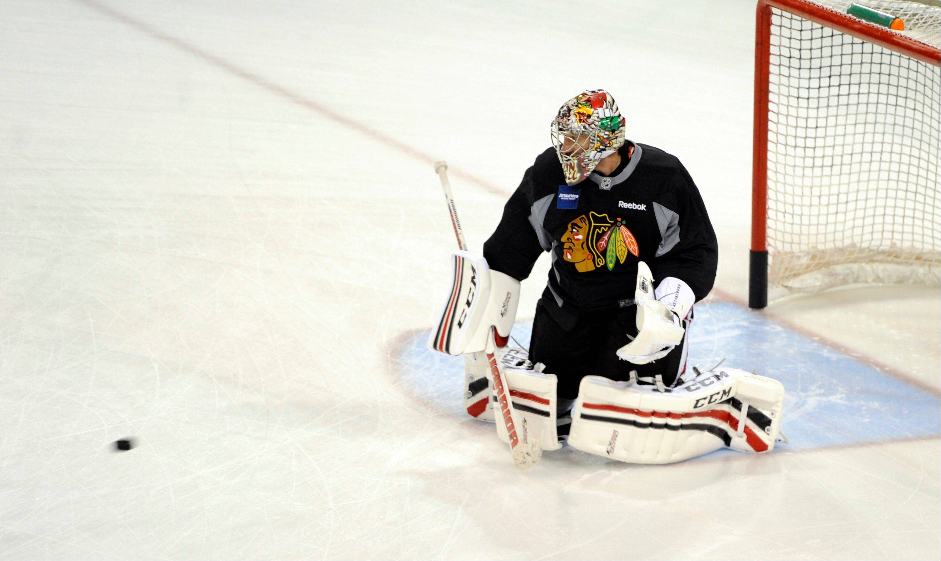 Nikolai Khabibulin, back with his second tour with the Blackhawks, says he understands his role with the team as they go through training camp at the University of Notre Dame.