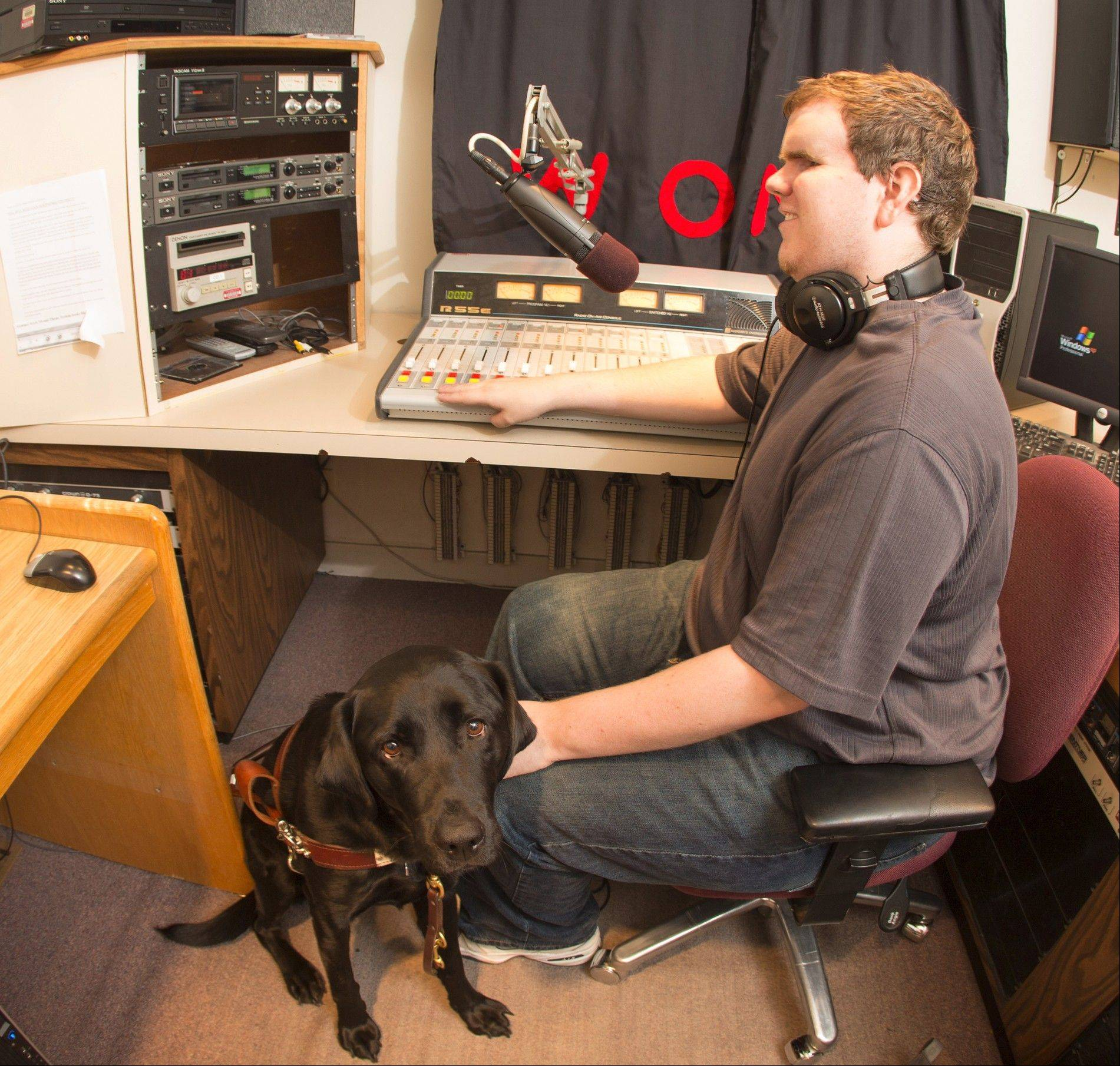 Ryan Henders, a North Central College senior and resident of Arlington Heights, negotiates student life with the help of his black lab Irby because of a rare eye disease. He is majoring in broadcast communication and has a show on the college-owned radio station, WONC.