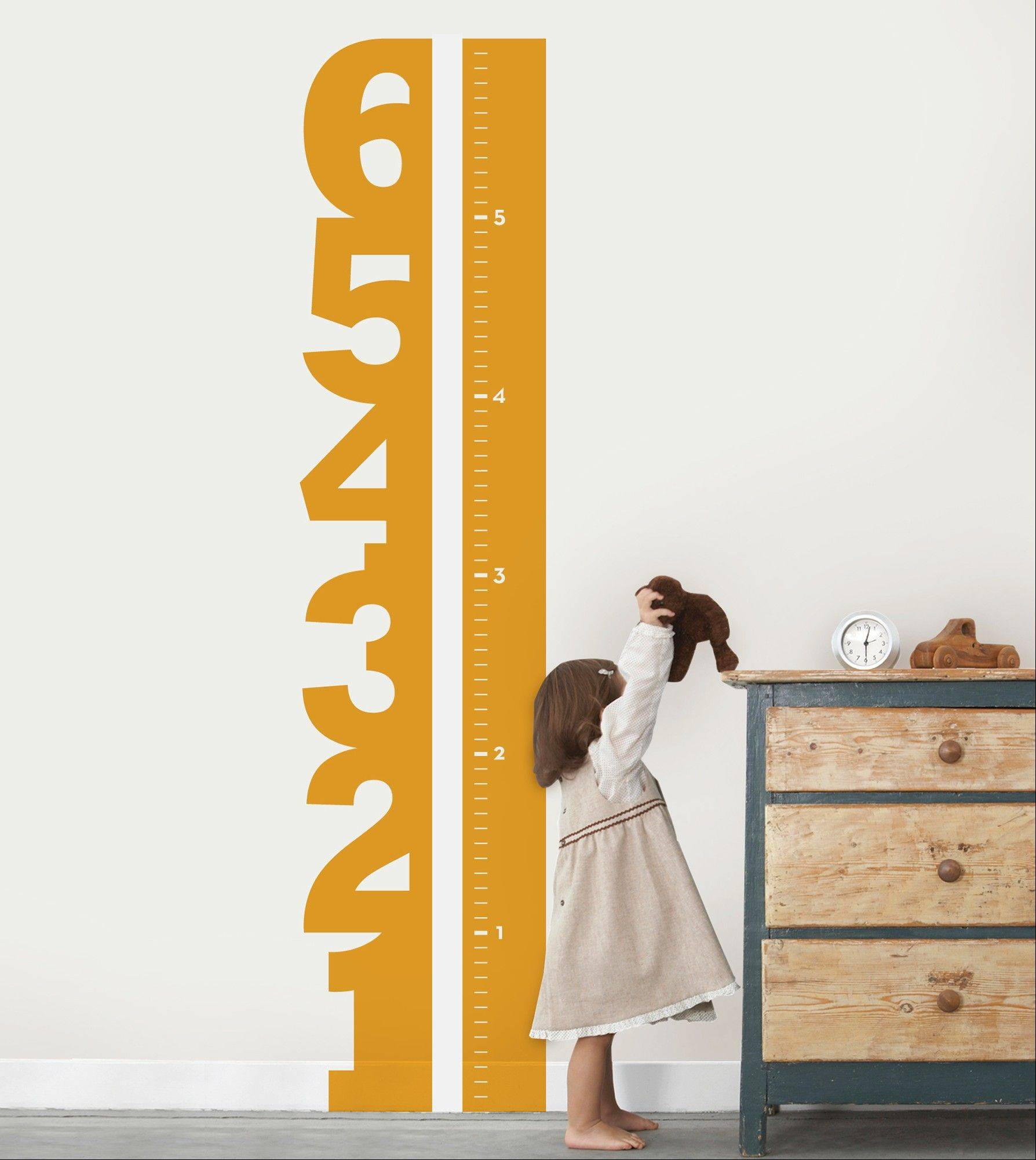 To put your walls to a practical purpose, track your child's growth with Simple Shapes' Growth Chart Numbers.