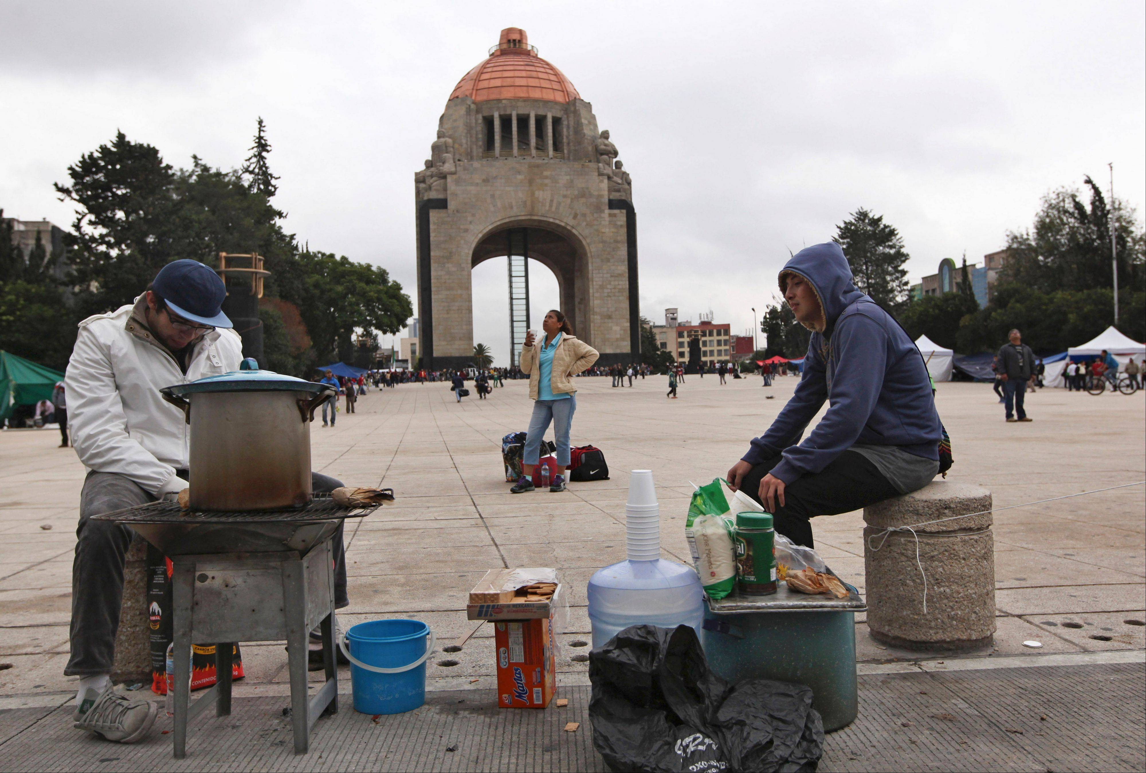 Striking teachers camp out at the Monument to the Revolution in Mexico City, early Saturday. Some teachers protesting President Enrique Pena Nieto�s education reforms reassembled at this monument after they were kicked out of the city�s main Zocalo plaza by riot police on Friday.