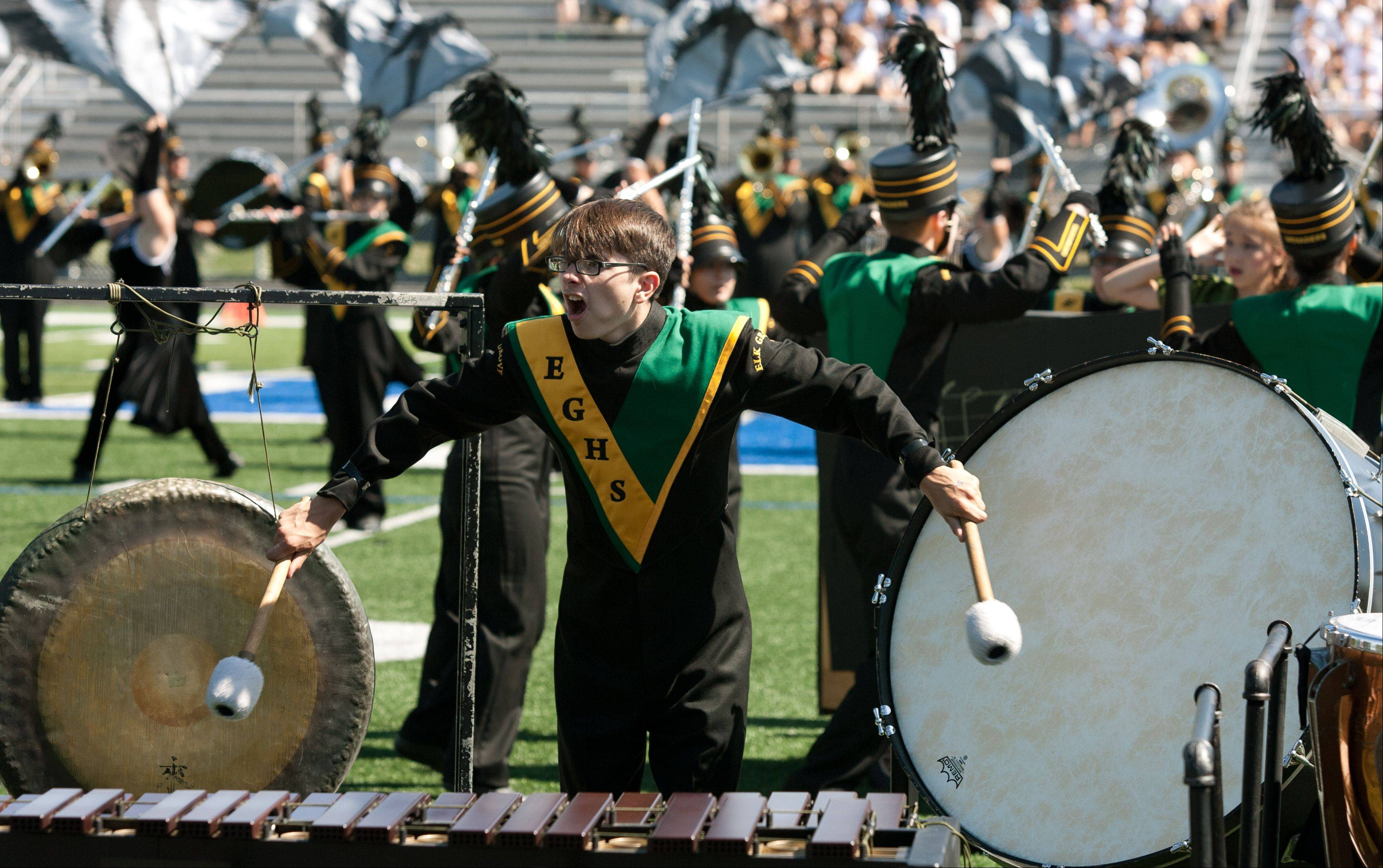 Elk Grove High School Marching Band member Michael Bravos plays the gong and bass drum during the 35th annual Lancer Joust Marching Band Competition at Lake Park High School in Roselle.